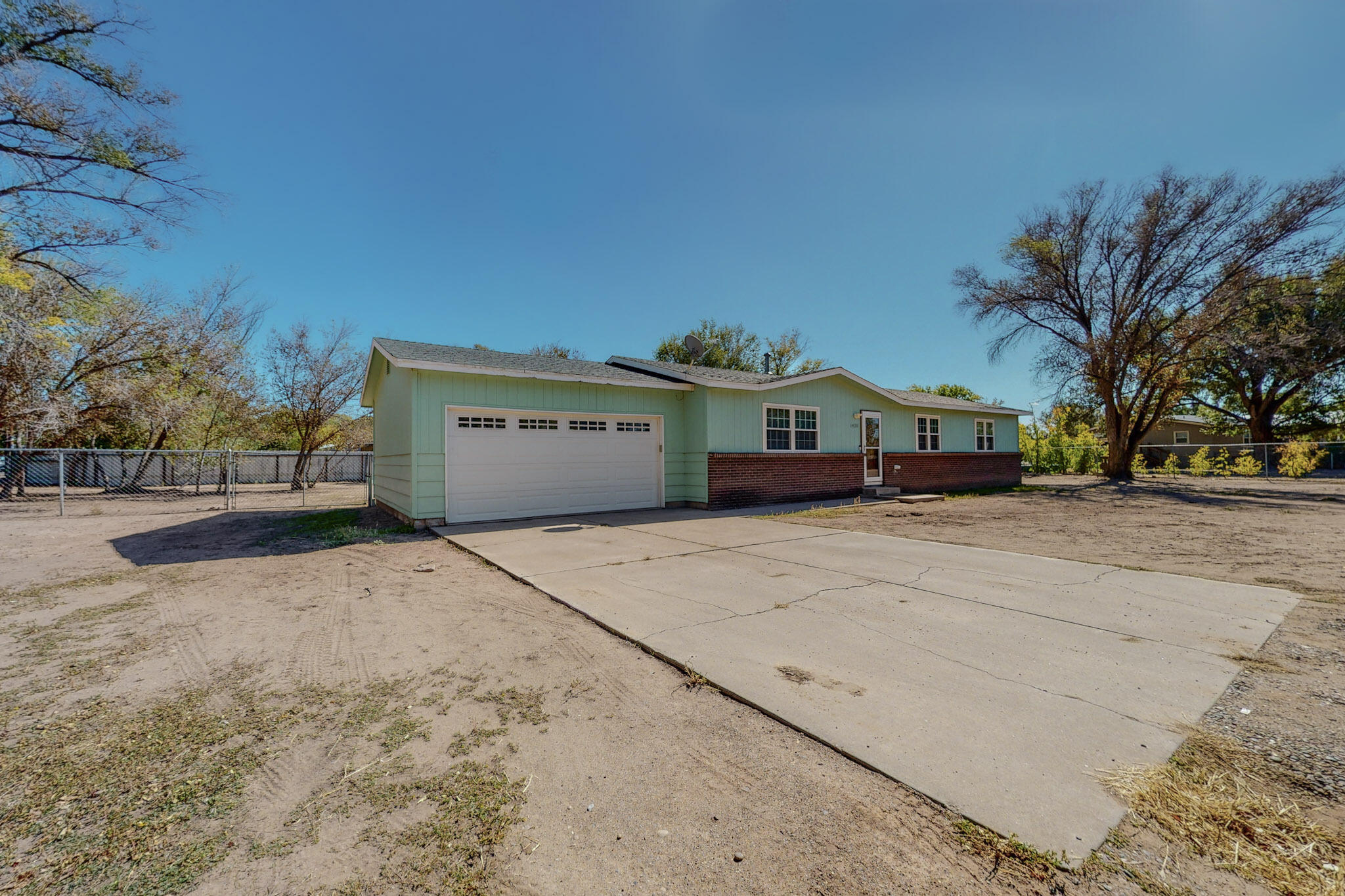 Single level in beautiful Bosque Farms. 3 bedroom with 1.75 baths located on a corner 1/2 acre lot.  One owner. Refrigerated air.  Brand new flooring. Newer roof with warrenty, New windows. City water, plus an irrigation well. Close to new elementary school!