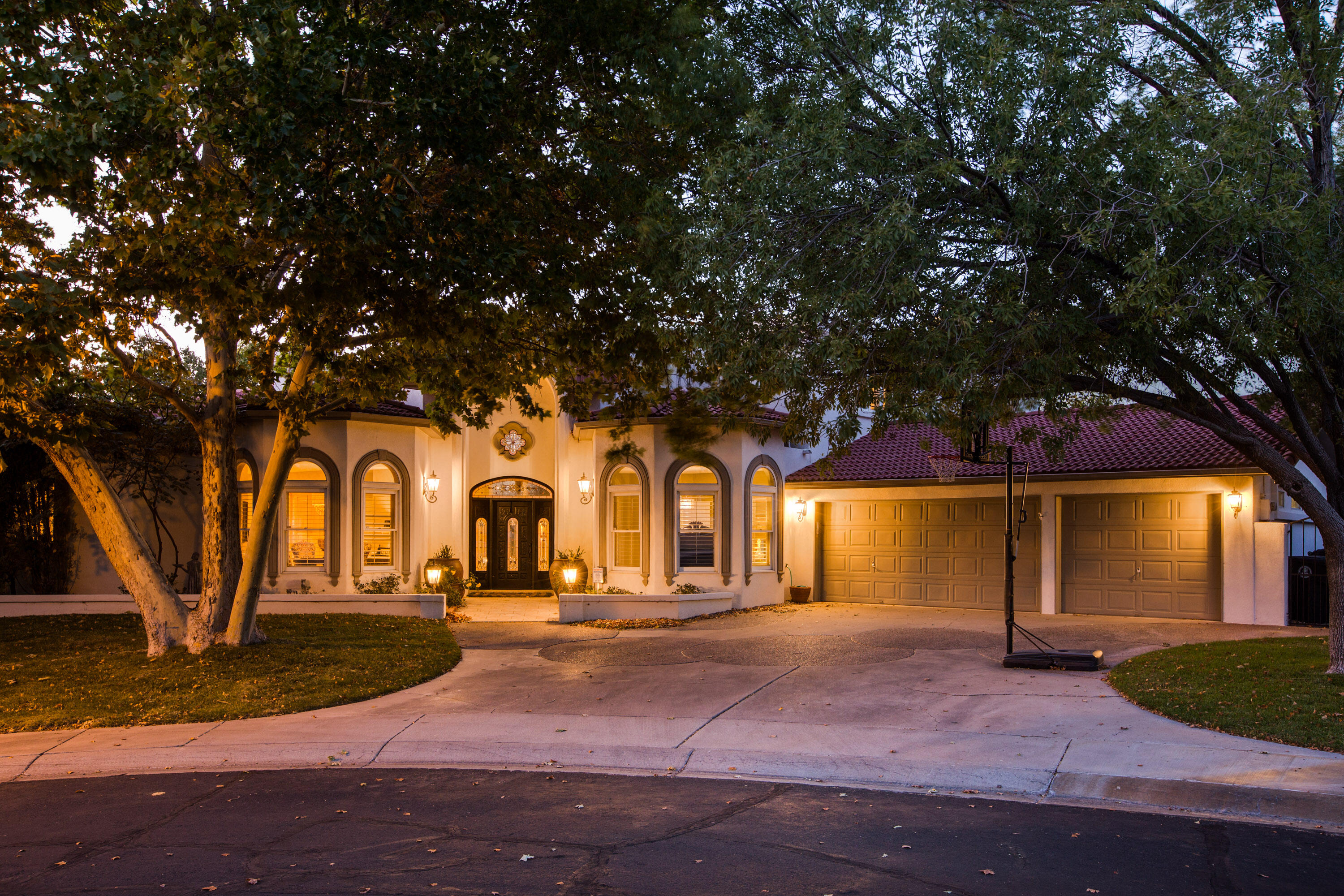 Incredible find in the 24/7 guard gated masterplanned community of Tanoan East. Enjoy the privacy and security of this great neighborhood with close proximity to the golf course, tennis courts, pool and country club. This great home features a hard to find main floor primary suite, a main floor guest suite with an en-suite bath, a huge great room, a nicely appointed kitchen with a breakfast nook, a pool cabana room with a bathroom and access to the  back patio, and an upstairs family room with 2 more bedrooms and another bathroom. The resort like backyard features a large pool, covered and open patios, and 2 huge side yards with grass for the kids to play! This home is nestled in a quiet cut-de-sac, and also features a 3 car garage with additional storage. What a rare find!