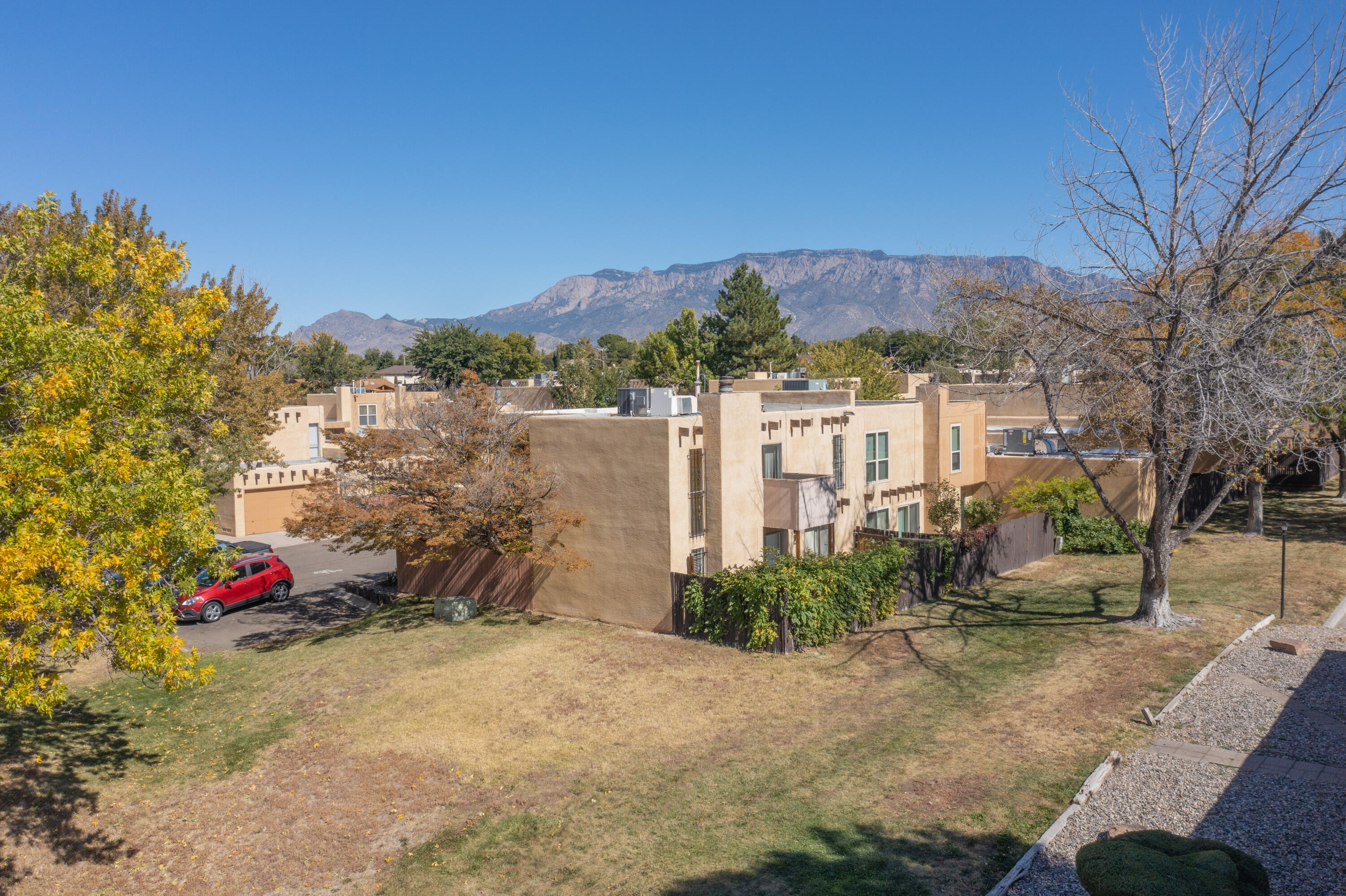 Welcome to this Bright, Beautiful, Updated, Move-in Ready 3-Bedroom Townhome in Northeast Albuquerque! *Community Pool + Refrigerated A/C!* 59 Plaza De La Noche greets you with a Stately, Soaring Raised-Ceiling, Gleaming Bamboo Wood Flooring, and a Toasty Wood-Burning Fireplace in the Main Living Area. This Renovated, Open Kitchen features Abundant Granite Counter Space, Bar-Seating, Pantry, plus Plenty of Storage. Appliances Included! Covered Patio w/ Lush Vegetation is Ideal for Entertaining or Simply Sipping Coffee in the Morning. Your Spacious Master Suite offers a Private Balcony, Sitting Area, and Walk-in Closet. Refrigerated Air Keeps You Cool during warmer months. A Sparkling Pool (Maintained by HOA) makes 59 Plaza De La Noche the Perfect Summer Staycation! Schedule your tour today