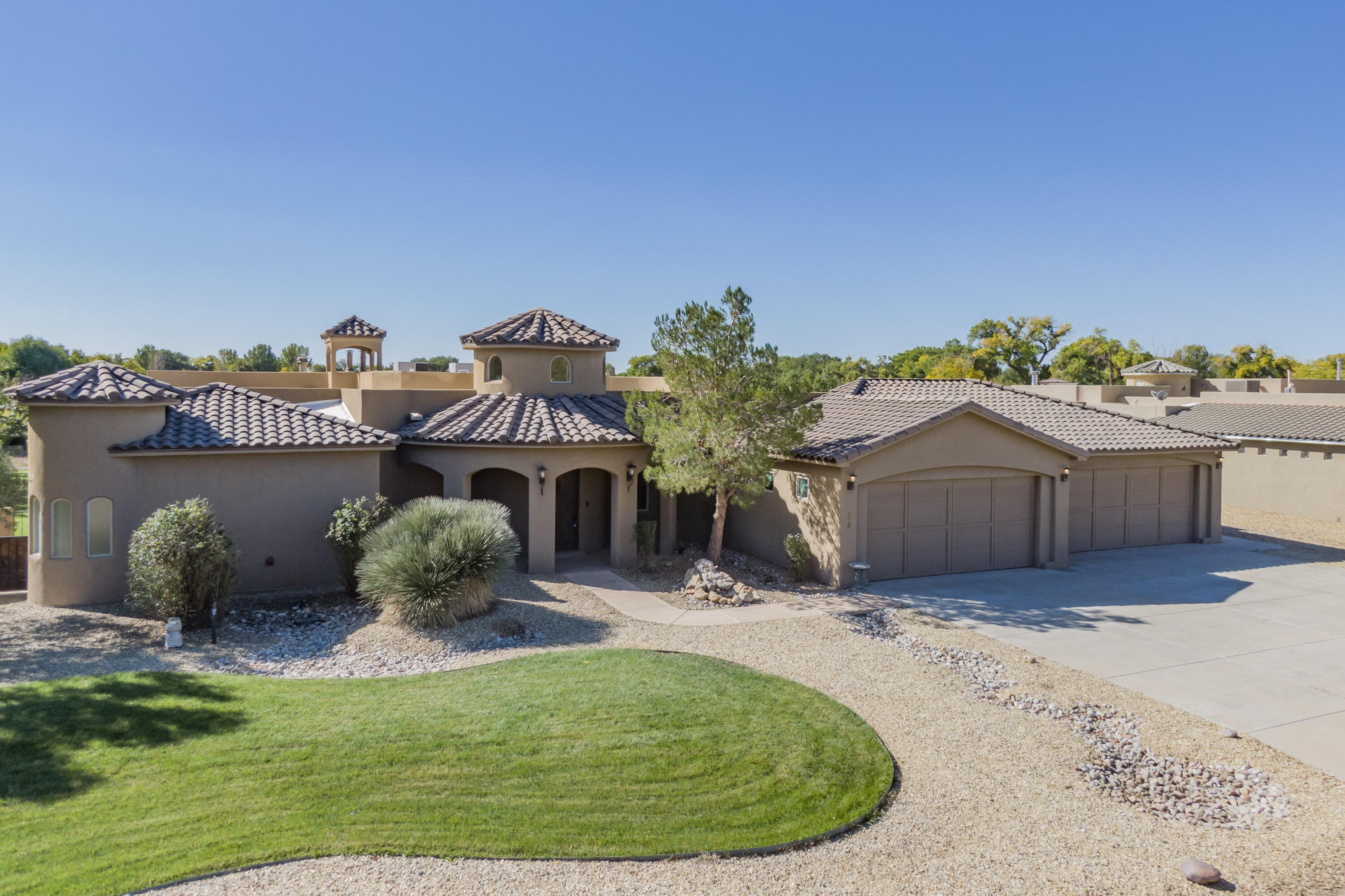 Come and take a look at this amazing custom-built home nestled in a wonderful, gated community in Peralta New Mexico. This gorgeous home features tons of amenities that will capture your interest, such as 2 irrigated acres with fruit trees, a very large covered patio area perfect for outdoor entertaining with a fantastic wood burning fireplace that would be sure to keep your guests warm during the colder months. Features also include granite countertops, a spacious pantry, 5 large bedrooms, 5 bathrooms, and a media room! This home literally has it all, including an attached 4 car garage! You do not want to miss out on your opportunity to own this spectacular home! Make an appointment today!!