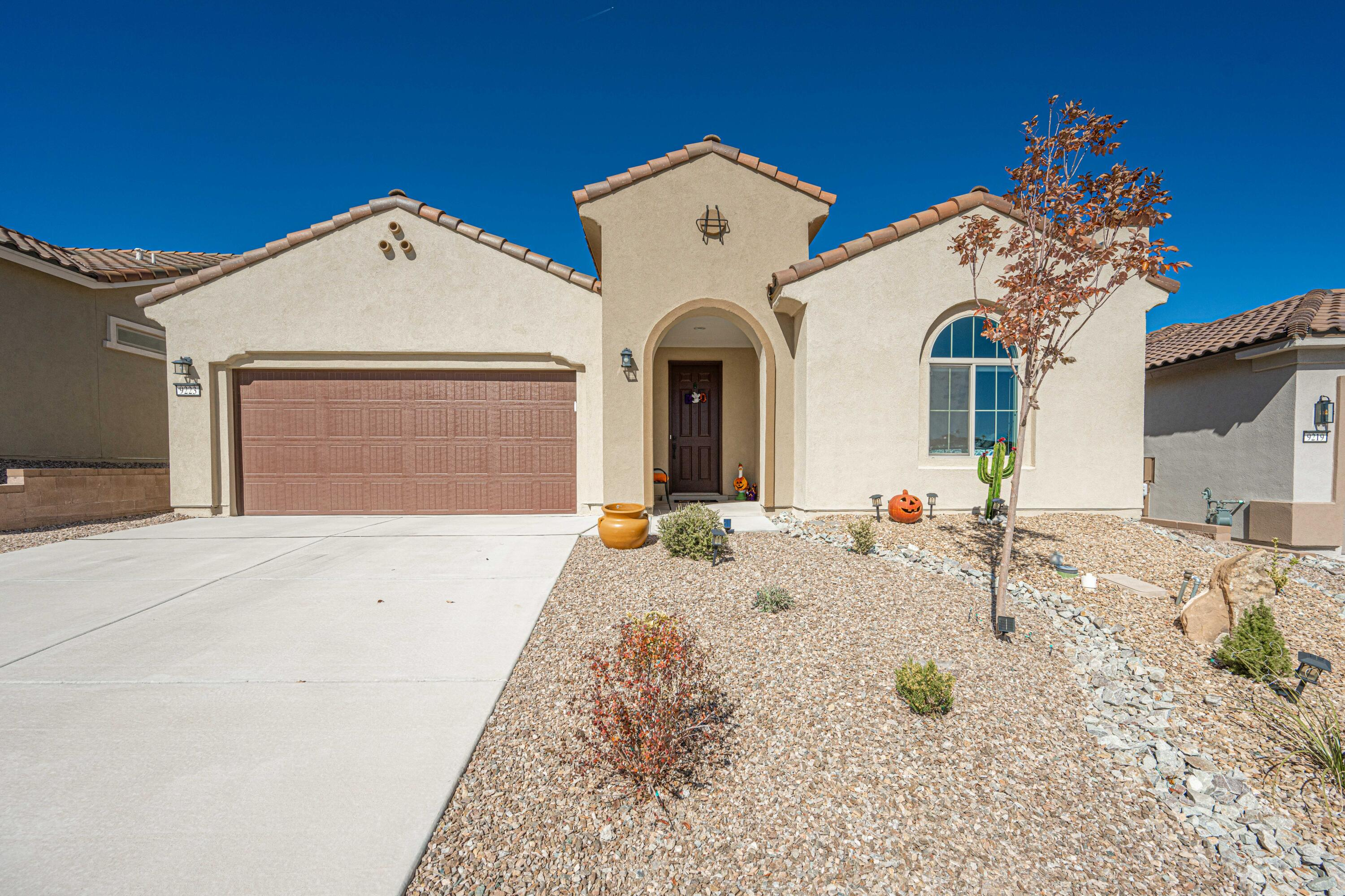 Welcome to Del Webb Mirehaven, a 55+ Active Adult Community!  This 'Preserve' floor-plan offers approx 2035SF, 3BR's, 2 Baths, beautiful Luxury SPC Vinyl Plank Flooring. Large Master Suite with walk-in shower w/bench and stone floor & tile surround, also Large Walk In Closet!  Kitchen has gorgeous Winfield White Icing Cabinetry, Quartz Counter-tops and nice tile back-splash, large island, huge pantry & SS Appliances.  Enjoy the nice view of the mountains and city from the custom landscaped backyard! REF AIR! Tank-less WH w/timer! Garage has additional storage space too! The Amenity Center has upscale GYM, Saltwater outdoor pool, Tennis Courts, Pickle ball Courts, Daily Activities, Cafe and so much More. Walking Trails to the Petroglyphs!  Minutes to Downtown ABQ, Airport and all amenities!