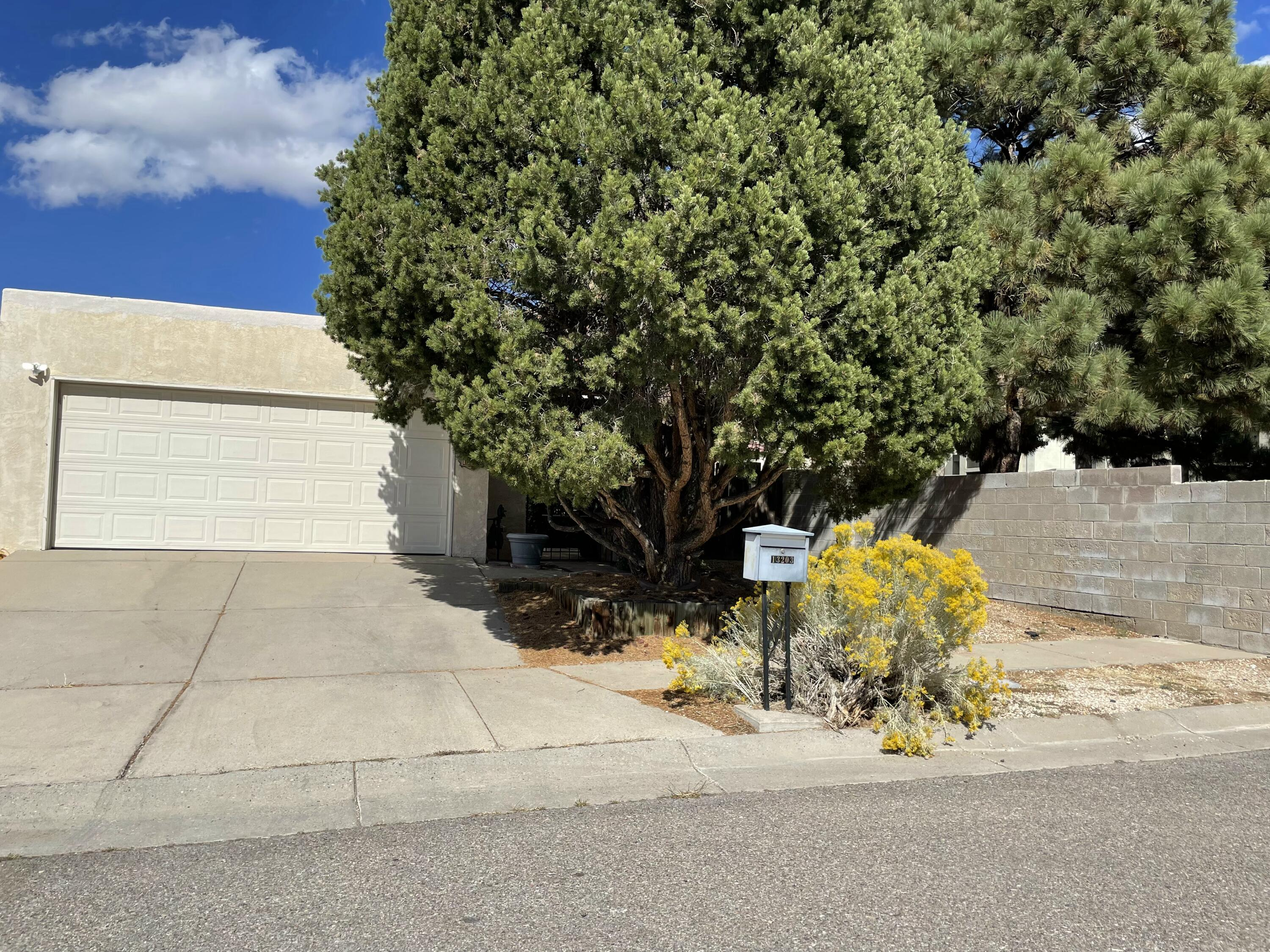 Well maintained townhouse conveniently located near Tramway and Lomas. It has a small gated courtyard entrance, open floor plan, and private backyard with extra space on the side yard! Updates include kitchen floor tile, carpet and laminate wood flooring-2015; new swamp cooler-2016; dishwasher, water heater, and garage exhaust fan-2018/19; and new roof-2018.