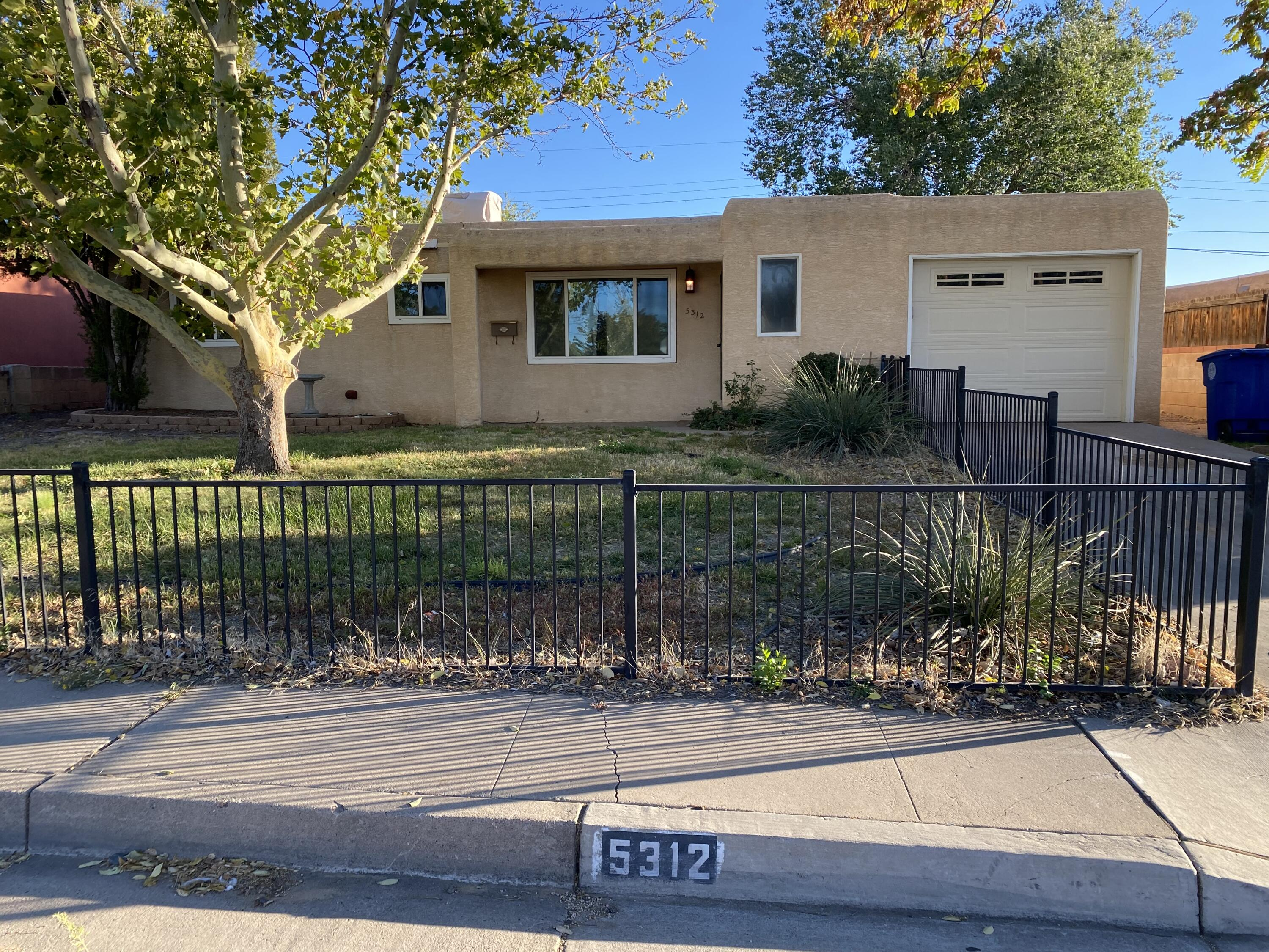 Great location and loaded with charm! This move-in ready open floorplan has updated windows, garage door, lighting, furnace, evaporative cooler, electric range, and refrigerator. Landscaped fully fenced front and back yard with grass, shade trees, and fruit trees. Washer and dryer included