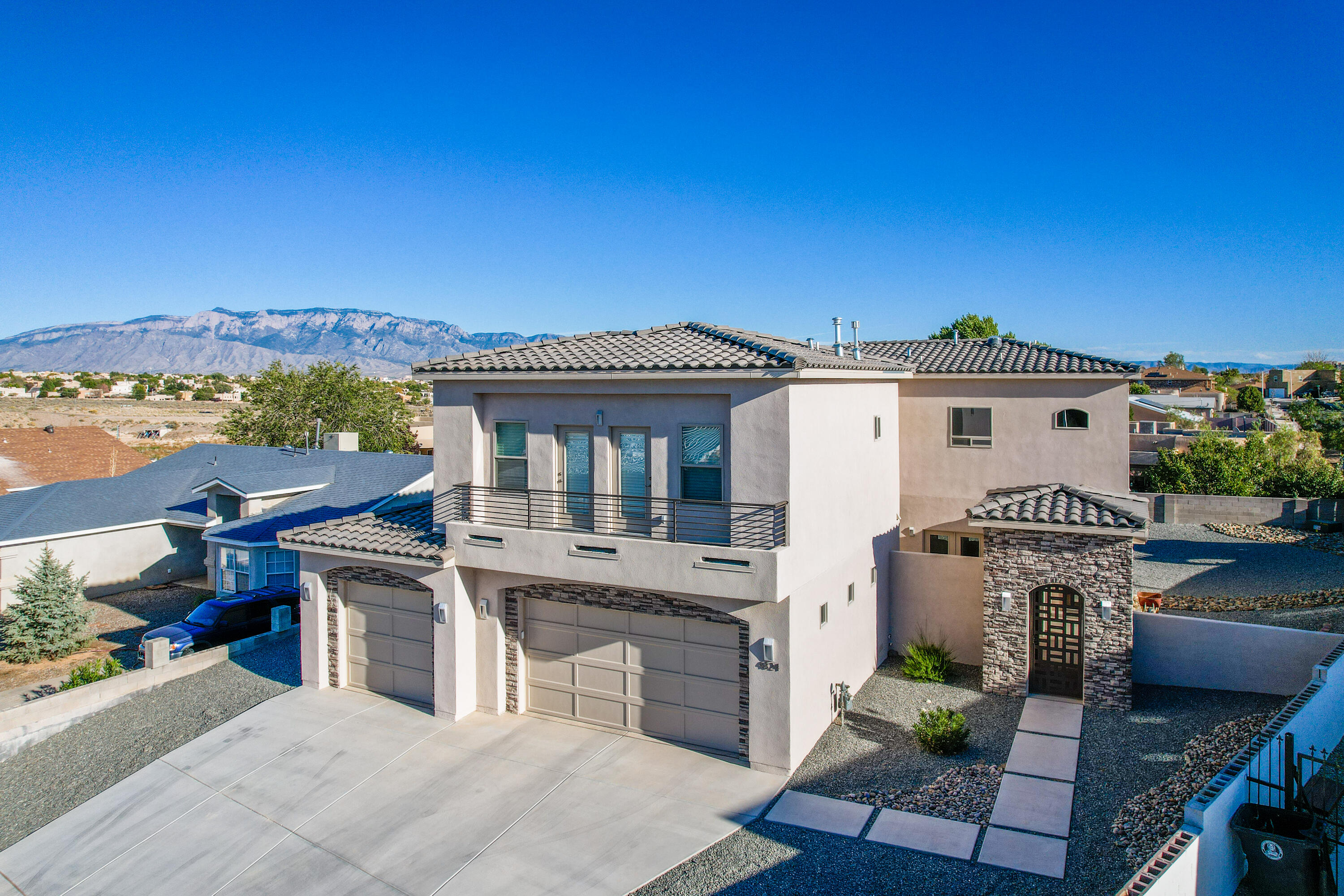 What a gem! This modern custom home built in 2017 is move in ready with upgrades throughout. Located on quiet cul-de-sac. Open concept living downstairs with gorgeous kitchen open to family room and dining room. Downstairs 3/4 bath is convenient and perfect for entertaining. Enjoy your front courtyard with multiple walk outs and gate house for privacy and security. Back porch faces southeast so grill dinner in the shade and enjoy your mountain views.Travel upstairs to find 4 oversized bedrooms. The owners suite has southeast facing balcony to savor city and mountain views. Huge walk in closet with upgraded cabinetry. Two of the secondary bedrooms share northwest facing balcony, each with private access.3 car garage for parking and storage. Schedule a showing today.
