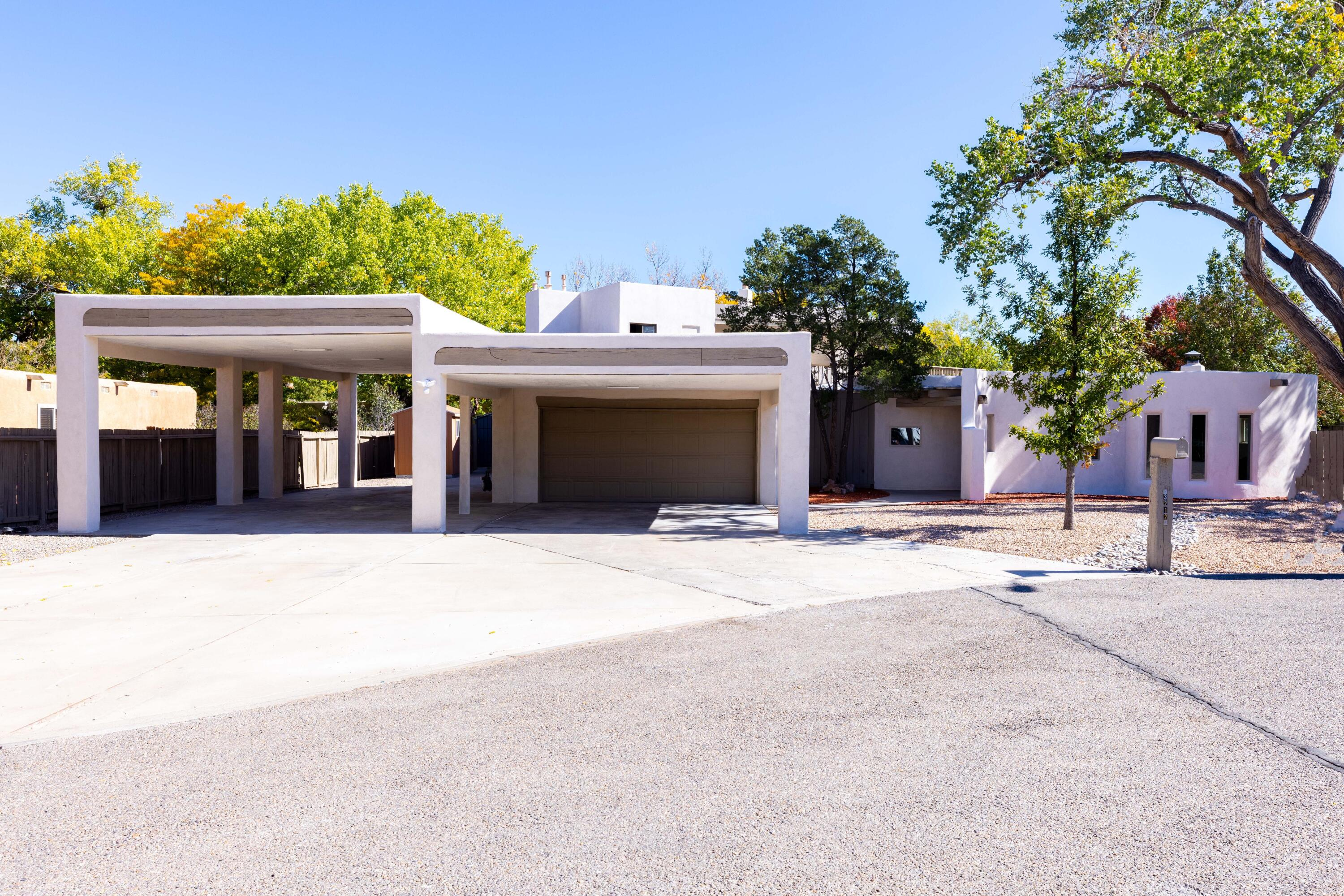 Come take a look at this masterfully renovated home in the heart of the North Valley! From the leathered granite counter tops to the venetian plastered kiva fireplaces this house has been transformed from top to bottom.  Complete with an indoor pool, two living areas, and two master suites that include spa like bathrooms you will have everything your heart desires. Refrigerated air throughout including the pool room, radiant flooring, outdoor water feature, an expansive master balcony and a very privately situated backyard are just some of the many many more features this house has to offer.