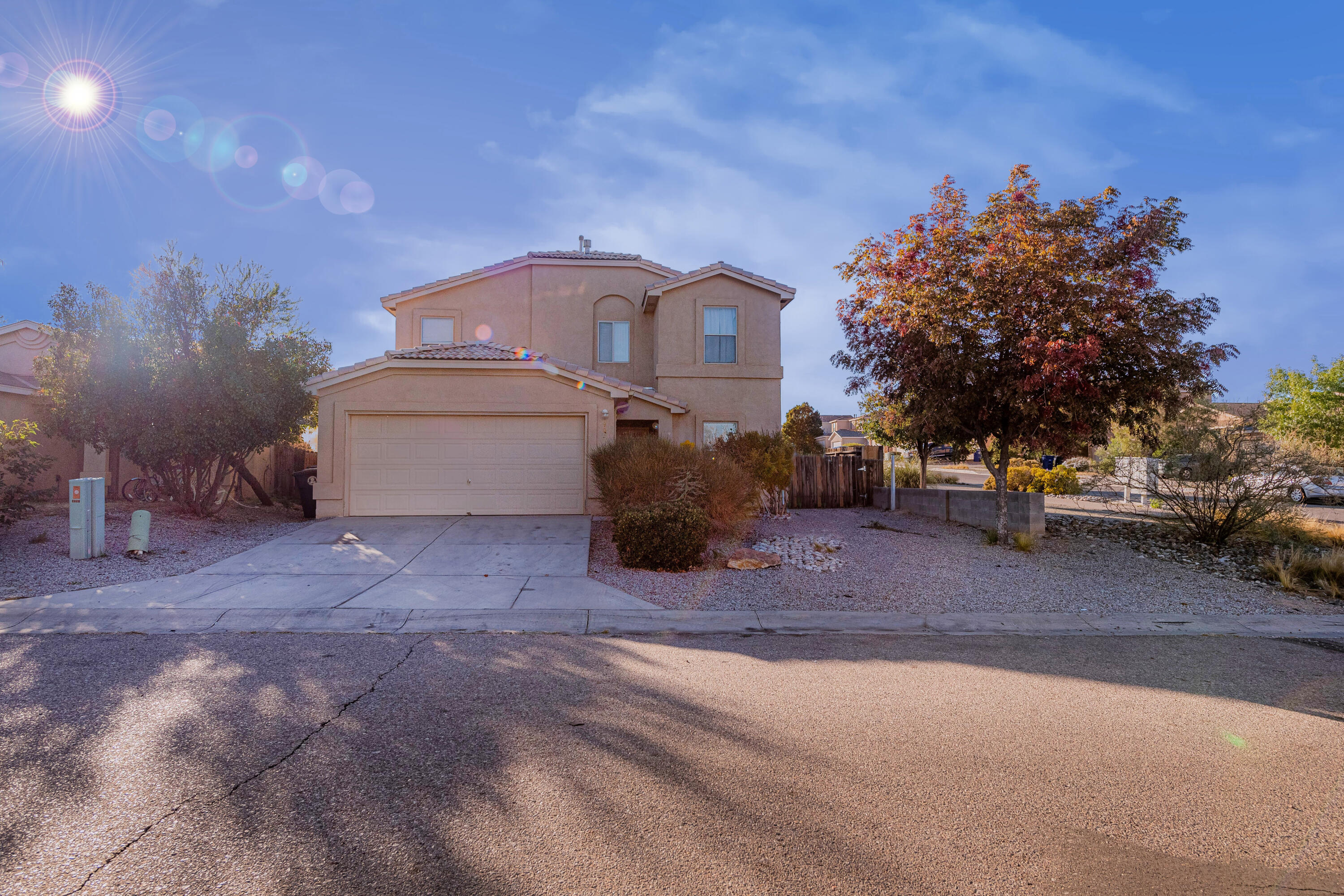 Beautiful house on a corner lot with back yard access features 4 bedrooms (one of them downstairs) and 3 full bathrooms. Tile throughout the house, nicely remodeled bathrooms. Backyard landscape with trees and plants. Two storages that match the house stucco. Schedule your showing now!