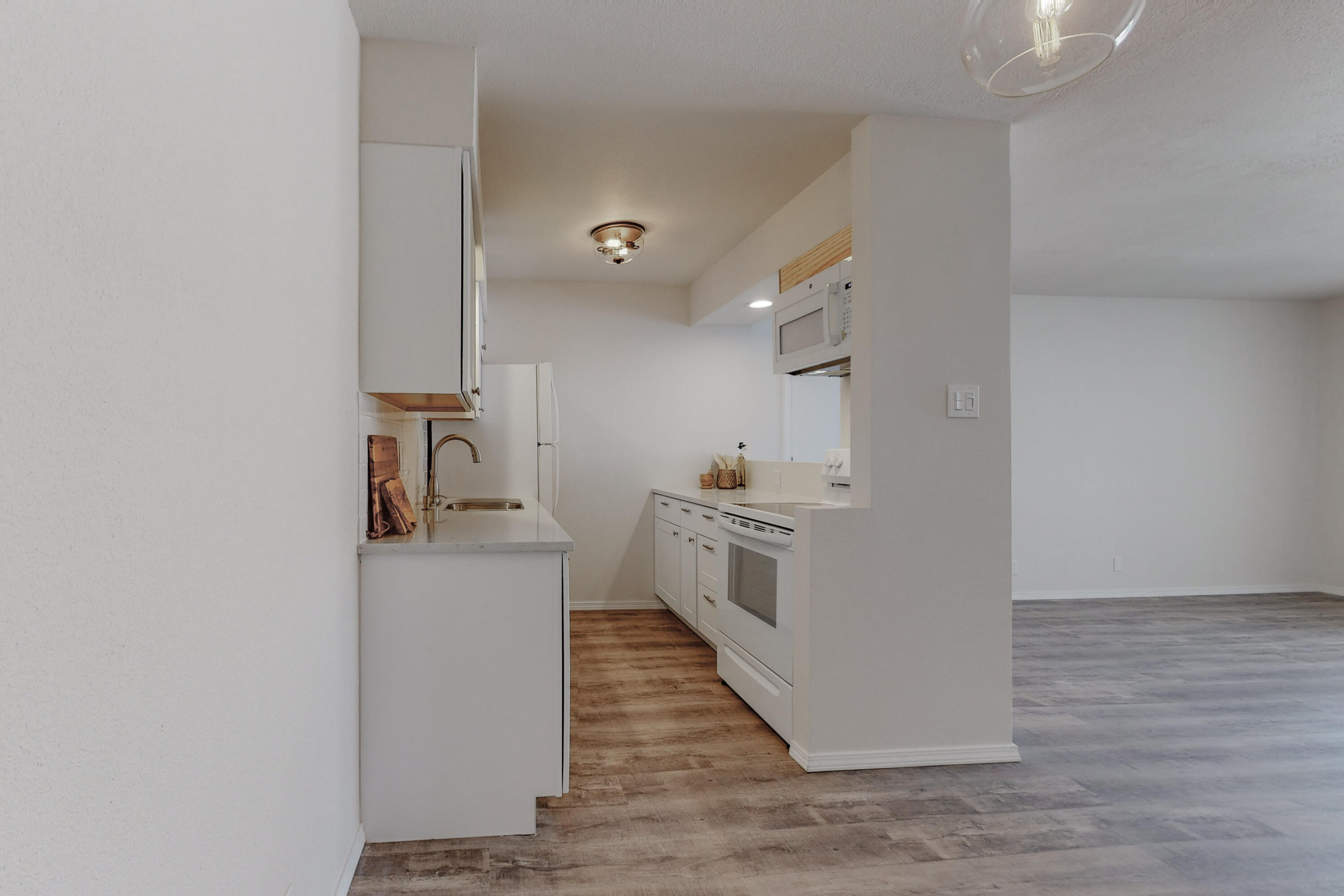 Gorgeous remodeled condo with a view! Darling property with top to bottom updates; renovated kitchen &, bathrooms including cabinets, subway tile, countertops, flooring, paint, raised panel doors, light & plumbing fixtures, chic barn door for the pantry and more! There is a sweet balcony on the far south side off the bedroom with no neighbor just sky, trees and mountain view too! Hurry, this could be your ABQ Dream Home!