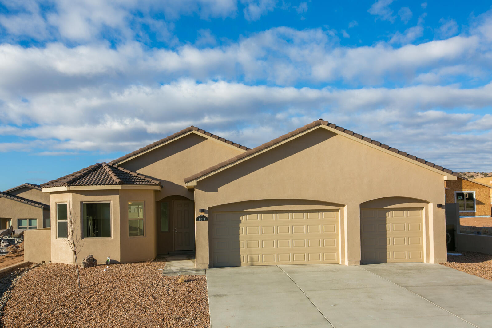 New construction on this beautiful new Twilight Home will begin soon. Pictures are concept renderings. Actual finishes and selections may vary. Get in on the ground floor of this new build in the desirable community of Mountain Hawk. Buy now and make your own tile, paint, stucco, granite, and carpet selections! Watch your home being built from the ground up. This home has such great standard features including a fireplace, Large walk in master closet, Covered back patio, double sinks in master, garage door opener, Stainless steel kitchen appliances include SxS refrigerator, range, dishwasher and microwave. Washer and dryer (white) in separate laundry room. Led lighting throughout. Build Green NM Silver Certified.
