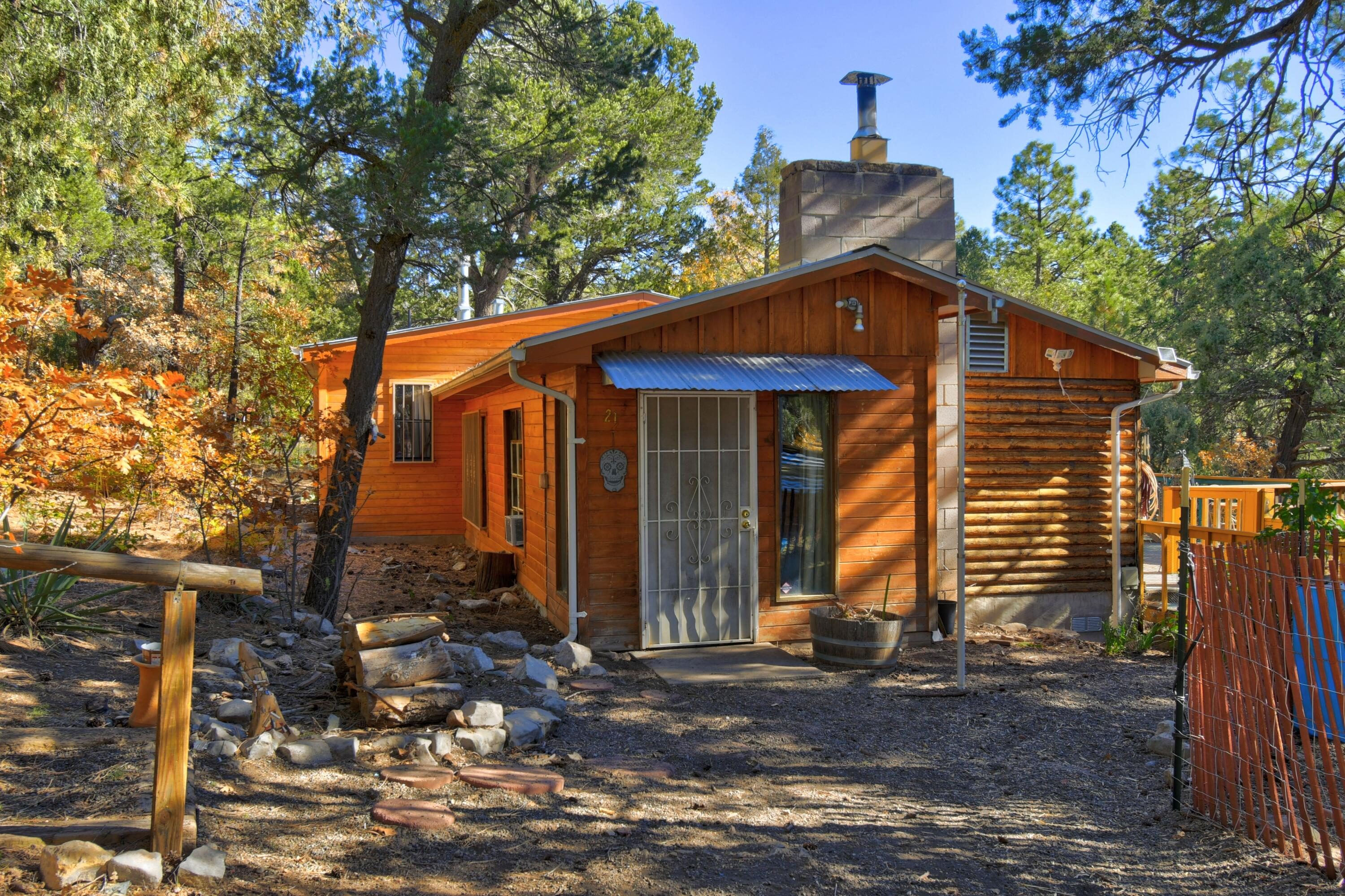 The cutest little cabin in the woods! Wood burning fireplace. Jetted tub. View deck off the back provides a lovely place to enjoy your morning coffee. Upgrades include  electrical, furnace, plumbing, flooring, security wrought iron, siding, soffit, siding, roof gutters and foundation under deck.