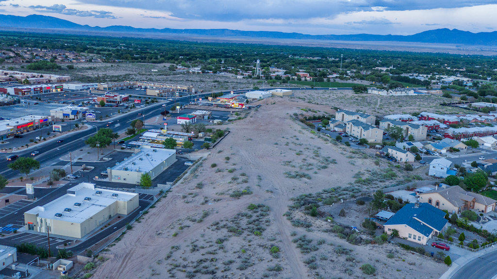 This property has an excellent location off Main Street in Los Lunas. Property sits opposite of LOWE'S, I-HOP, APPLE BEES,  AND PROPERTY SITS SOUTH OR BEHIND SONIC, O'RIELY. property has two access points with easy access. BOOMING VALENCIA COUNTY..  SUBJECT IS great for many commercial uses.  and had tremendous VIEWS.