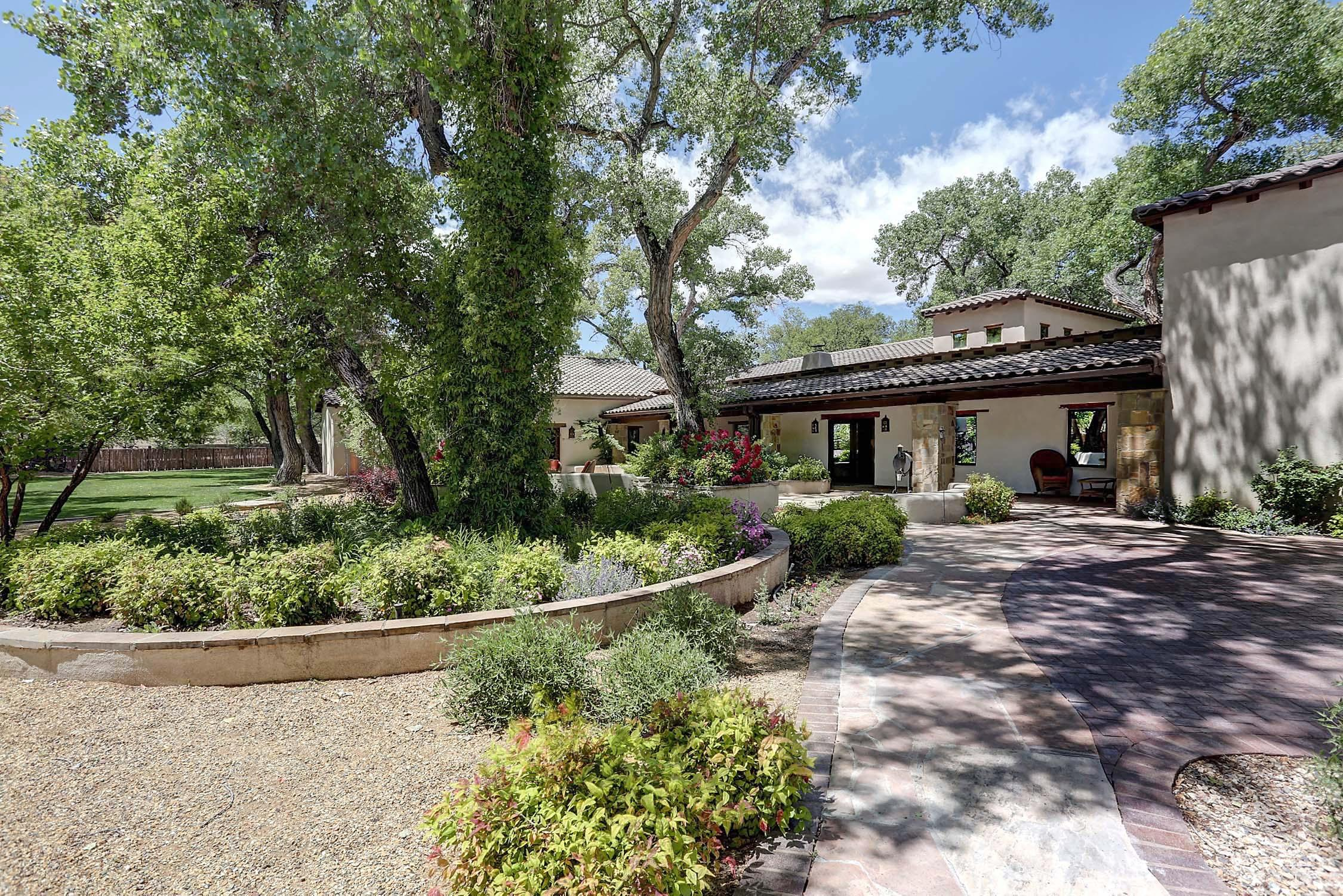 Travel Down a Cottonwood Lined Lane and Be Transported to Another World * Behind the Custom Metal Gate a One of a Kind Compound Awaits on Three Glorious, Wooded, Fenced Acres Abutting the Bosque and River * Understated Elegance in a 5981 SF Main House, 1605 SF Casita, and 1655 SF Guest Quarters/Gym/Office * Fully Walled Swimming Pool with Bath House * Eight Garage Spaces * Three Stall Horse Barn with Tack Room * Direct Horse and Walking Access to Bosque Trails * The Main House Is a True Work of Art with Generous Use of Natural Materials and Quality Finishes * A Classic New Mexican Adobe Transformed with Modern Features and Amenities * Geo Thermal Heating/Cooling * Architectural Digest Kitchen with Timbered Ceilings, Fireplace, Wolf/Sub-Zero/Thermador Appliances