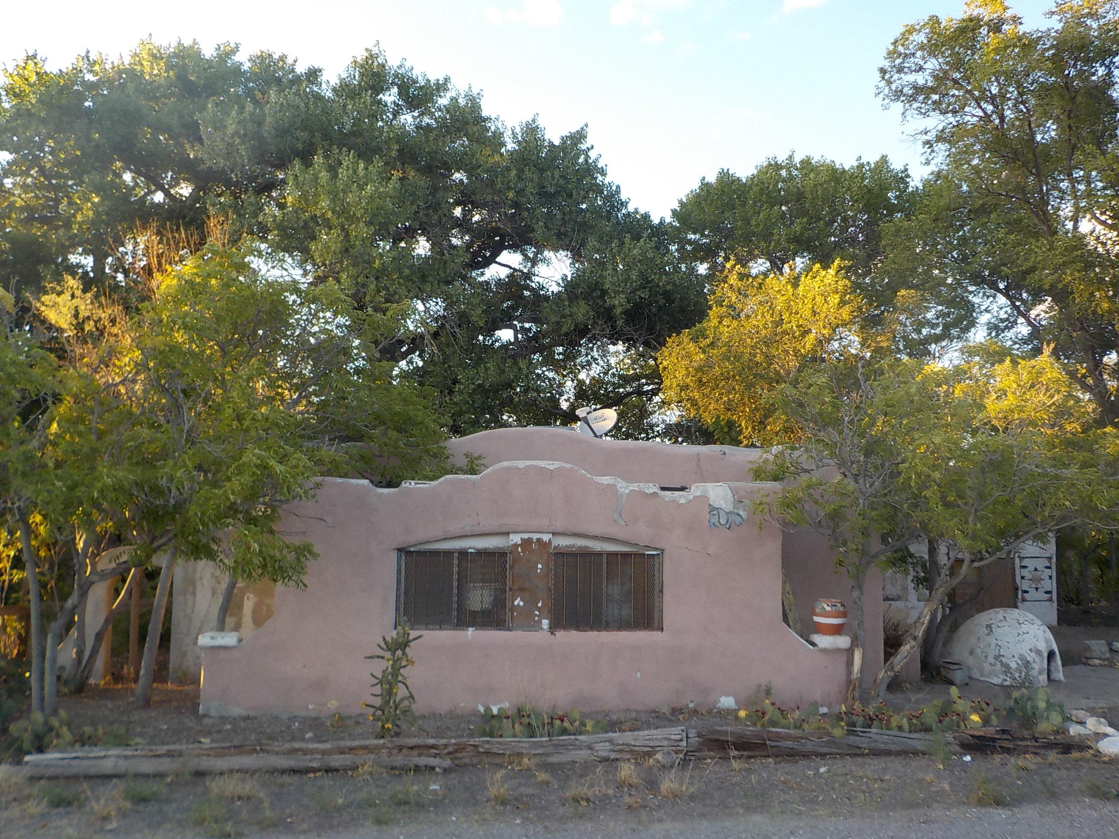 This charming adobe home was a trading post back in the 1800s!  Lovely mature trees grace the embankments of the active acequia.  The interior of the home has southwestern appeal.  A sturdy basement can be used for extra storage.  The casita next door is included, and is allowed by the special Algodones zoning, along with light retail and commercial.  Seller credit for utility allowance at closing.  Title commitment and staked survey have been completed.  The block building is awaiting your creative design.  The lot extends past the footbridge over the seasonal water.  Algodones is a wonderful small town with easy commuting to Santa Fe, Rio Rancho & Albuquerque.  Come see this unique property!