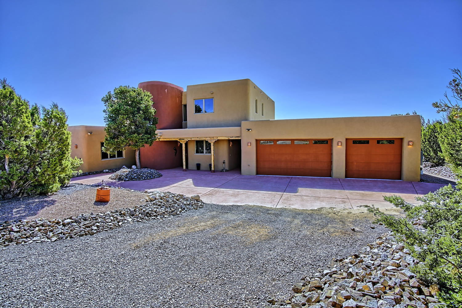 TRANQUIL PUEBLO! A Secluded and Private custom home built with Apex walls, it is fire-, insect and allergy-proof, utility-friendly and amazingly comfortable- see documents!  Enjoy this beautiful private wooded property  at the end of the road with views of South Mountain up close. Enjoy entertaining friends with 2 backyard expanded patio areas  - covered portions 23X16 & 30X9.5, a huge loft deck. with amazing views & the sound of water coming from a lg pond. Many wonderful features, incl, spacious rooms, abundant storage, 3-car garage and 17X15 workshop, well-equipped kitchen,  diamond plaster walls, on demand hot water heater, jet tub, Pella wood & metal clad windows, almost all fenced and gated with great privacy.  This very special home is ready and waiting just for you...YOU'RE HOME!