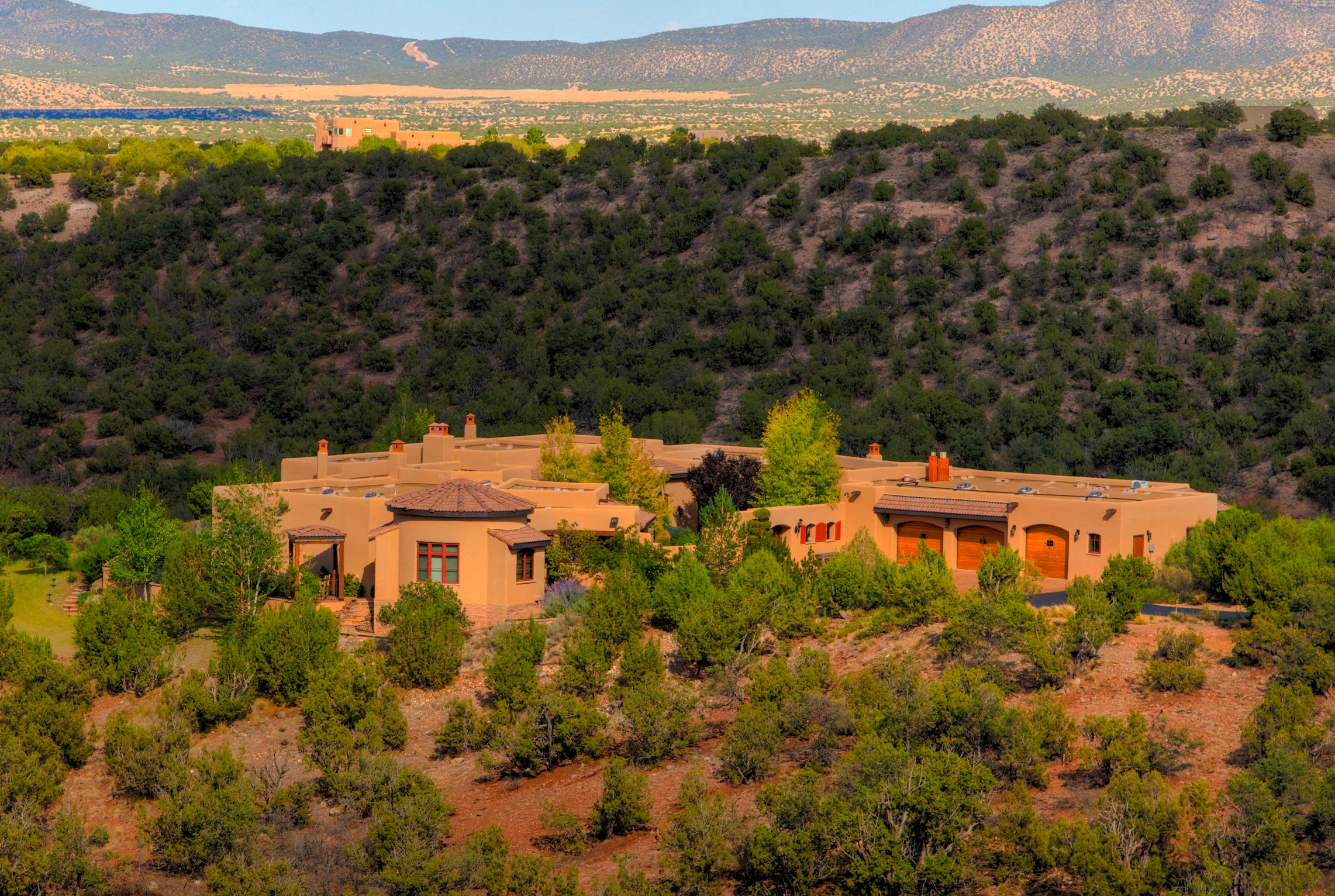 Prepare to be AWESTRUCK with this one of a kind luxury estate situated directly on 2,000 acres of eternal open space overlooking the magnificent red-rock canyon. A gated paved driveway & a stunning Bison sculpture greet you and lead you down towards your extremely private 6,055 sqft piece of paradise, equipped with its own look out tower, allowing one to fully immerse in the picturesque scenery which lavish this home. Immaculately maintained, the craftsmanship in this home will leave you in amazement, from imported 150 year old white oak reclaimed beams, custom made sconces & light fixtures, imported tile, Mahogany wood cabinets & doors including garage, along with hand troweled diamond finish plaster walls just to name a few. The Master Suite is a true haven and is comprised of 5 rooms