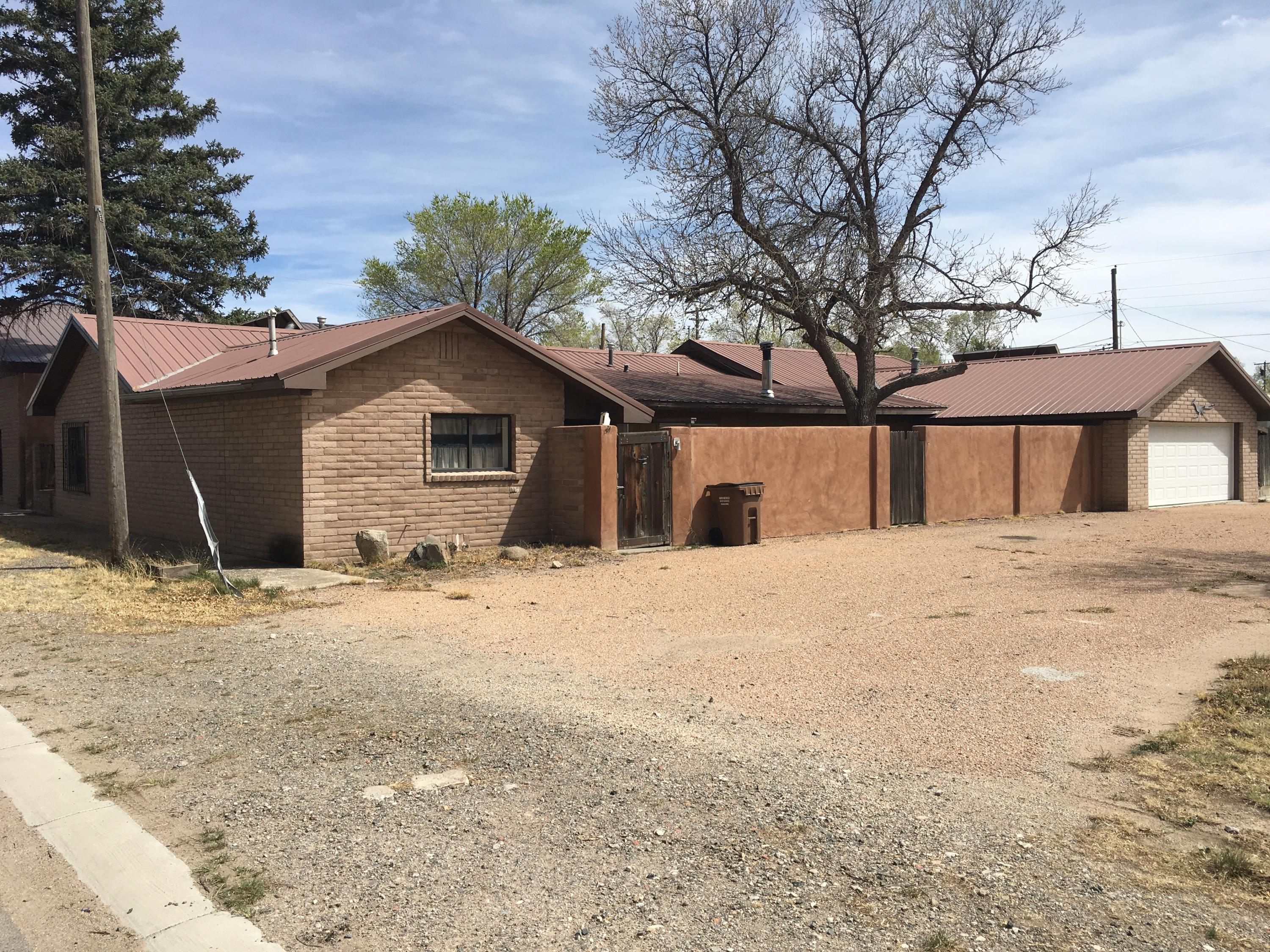 For Sale home in town of Estancia NM Torrance County. Centrally located with an hour drive to Albuquerque. Just over an hour to Santa Fe. Easy access to Hwy 41, the I-40 corridor or Hwy 60. The home is located in town at 509 Arthur Estancia, NM 87016. Close to the Estancia Public Schools. The home is 3,600 sf with 3 bedrooms and 3 bathrooms. Just needs a little TLC & fixer upper skills & it would make a nice family home in the heart of Estancia New Mexico. There are several rooms to choose from for bedrooms, dining room, living room & family room. The attached garage serves for laundry, storage,  small workshop. The library, park, fire station, post office & Torrance County NM fair grounds are within walking distance. Come to Estancia for the small town rural lifestyle.