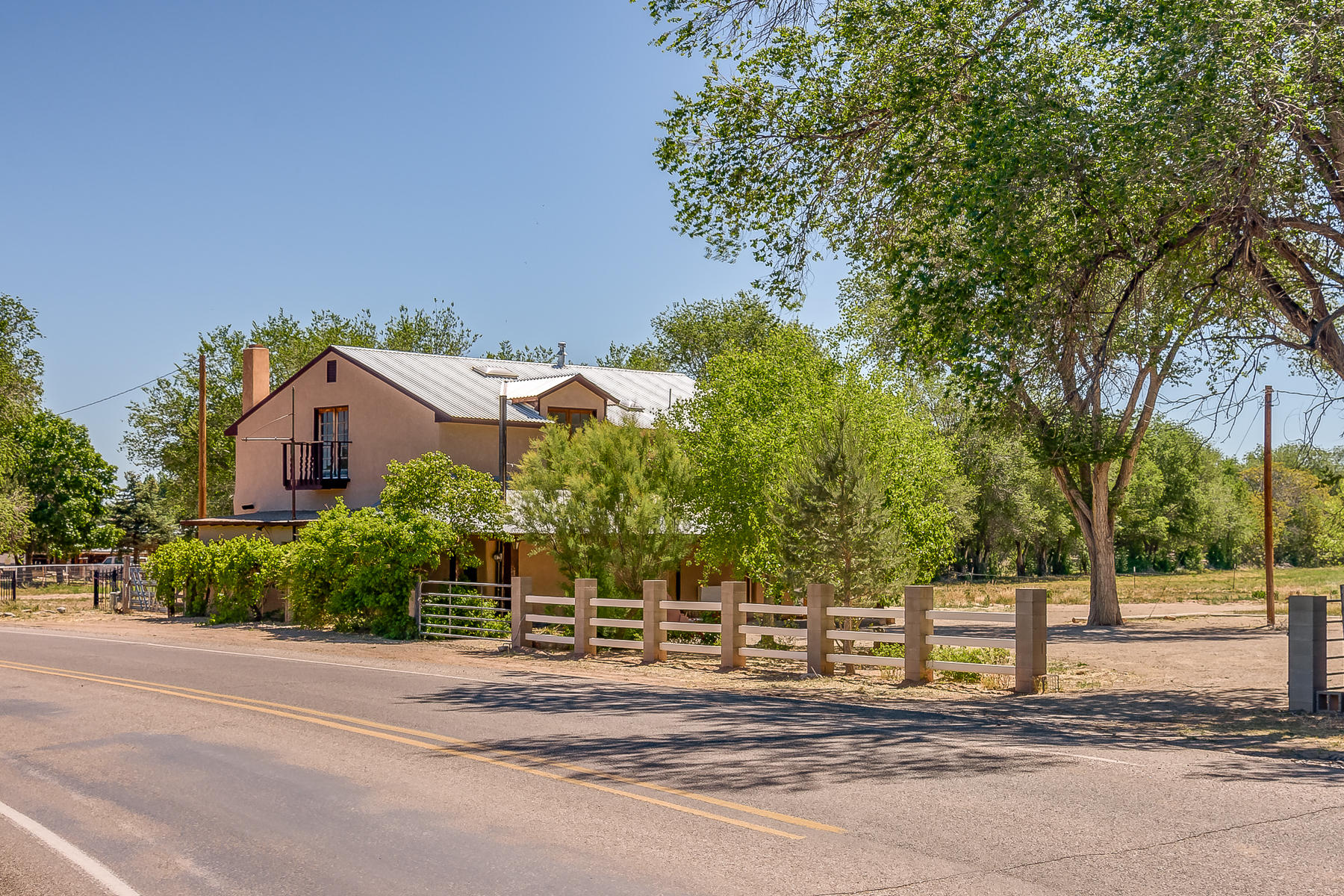 Dreaming of the country life? Look no further! Northern New Mexico style adobe farmhouse on approx. 3.5 ac, detached 2 car garage, RV cover, and carport. A large irrigated alfalfa field could provide feed for your horses, or could be harvested for sale. The home features 2 bedrooms downstairs, and a huge master suite upstairs with a private deck to enjoy the morning sunrises, wood beam ceilings, and newer vinyl windows. Located between Albuquerque & Santa Fe, & close to the up & coming town of Bernalillo -- home to the Range Cafe, Bosque Brewing & the new Riverwalk development @Rio. The home is currently being remodeled, and may not qualify for conventional financing in its current condition. Get this property now before the owner completes the renovation and increases the asking price.