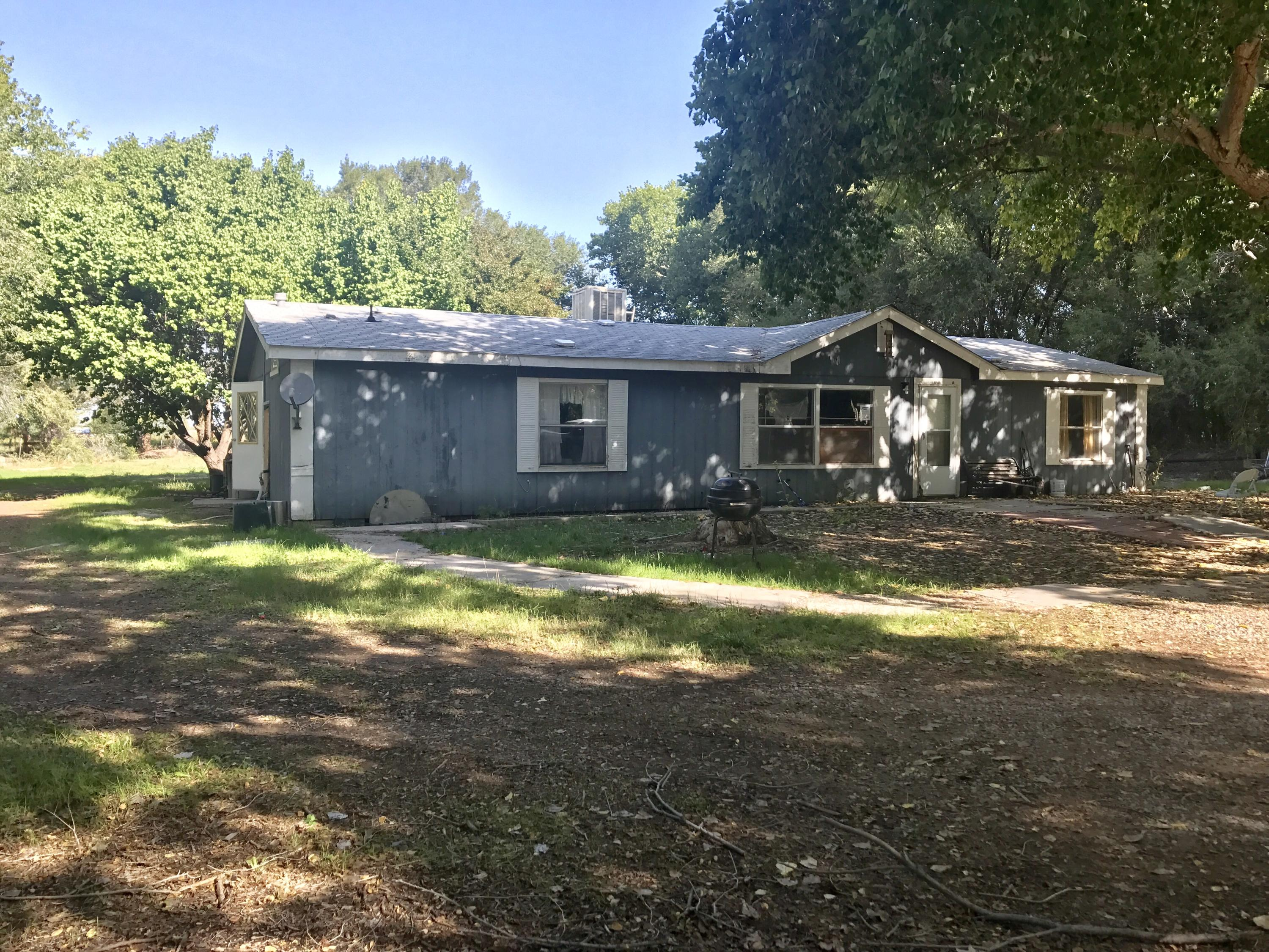 Beautiful location! This three bedroom, two bath home has a big open floor plan, great big kitchen,  fully fenced yard with established tress around the property, and the space to meet your needs! If your looking to build for more room or want animals-- this is the property for you!