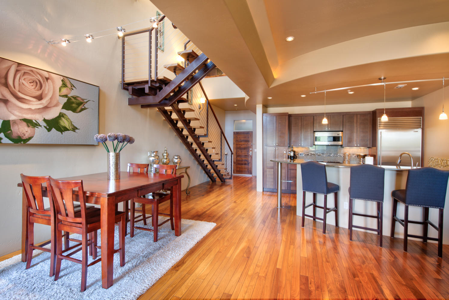 Immaculate Luxury former Model condo in the Heart of Nob Hill just steps from shopping, restaurants, parks and much more! Beautiful hardwood floors, granite counters, Wolf stove/oven, Sub Zero Fridge, 2 Master Suites, large windows, 2-car garage, Views of Central from balcony and so much more! Mountain Views from the large common area deck.  Very well cared for home is in need of new owners.  Come see this beauty today!