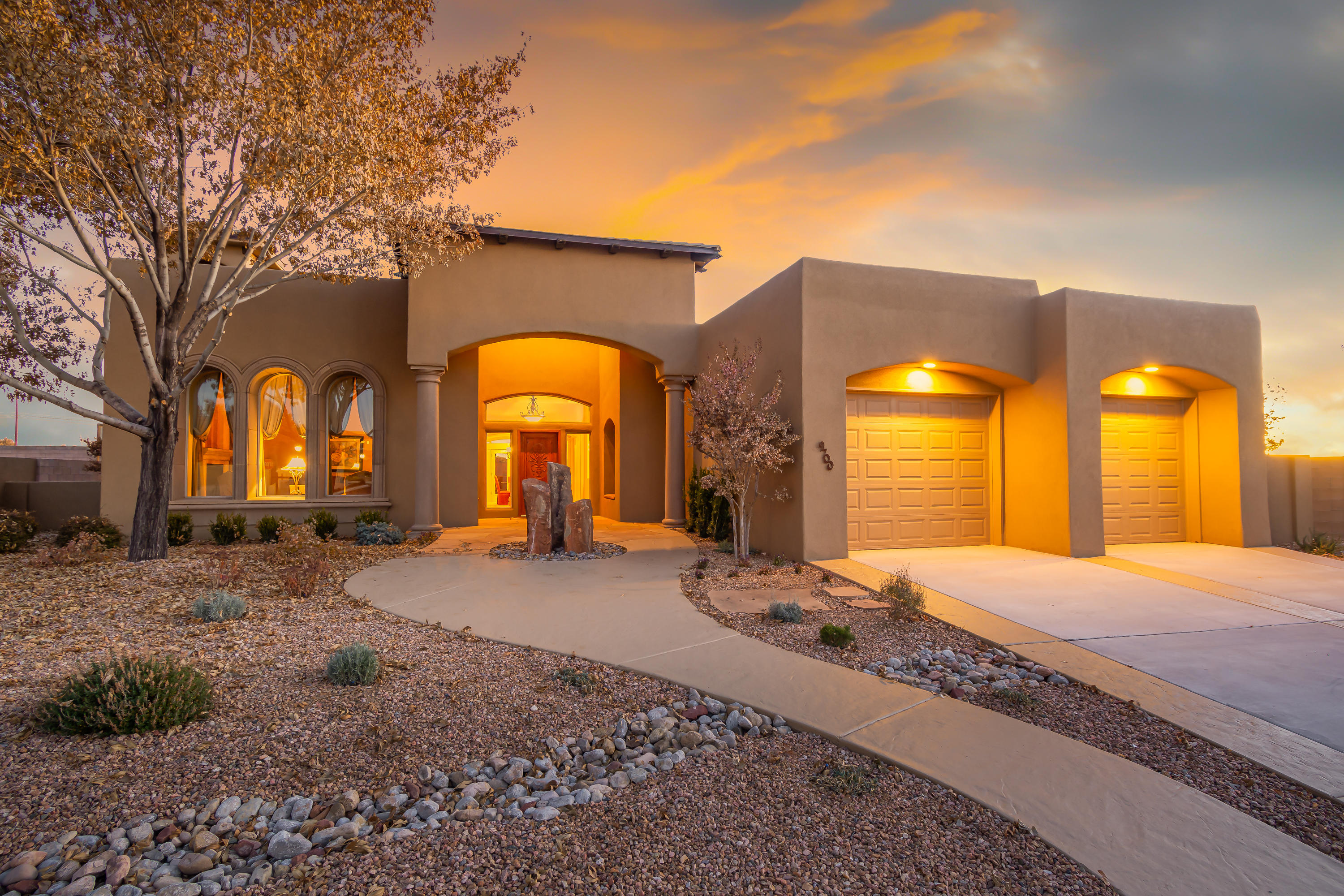 Luxurious Panorama model home located in the prestigious gated Octillo  community on a large .25 acre property. Home features the finest finishes with a classic design. Grand entry with a stunning skylight and custom tile work. Gourmet kitchen with designer cabinetry, granite countertop, built-in ovens/microwave, custom range hood, backsplash, center island  with seating space, a beautiful skylight and a breakfast nook with stunning mountain views! Enchanted living area with a stone wall, gas fireplace and built-ins. Romantic master suite with a 2-sided fireplace and a spa-like bath. Bath host dual sinks with a custom vanity, jetted bath accented with roman columns, walk-in shower & closet. Great outdoor living space with w/ a huge covered patio that flows to an open patio w/ a fireplace.