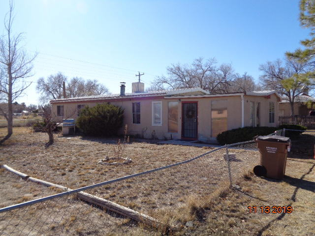 older well maintained manufactured home close to schools, shopping, step back in time when neighbors new each other small town America yet still close enough for commuting to Albq or Santa Fe for work