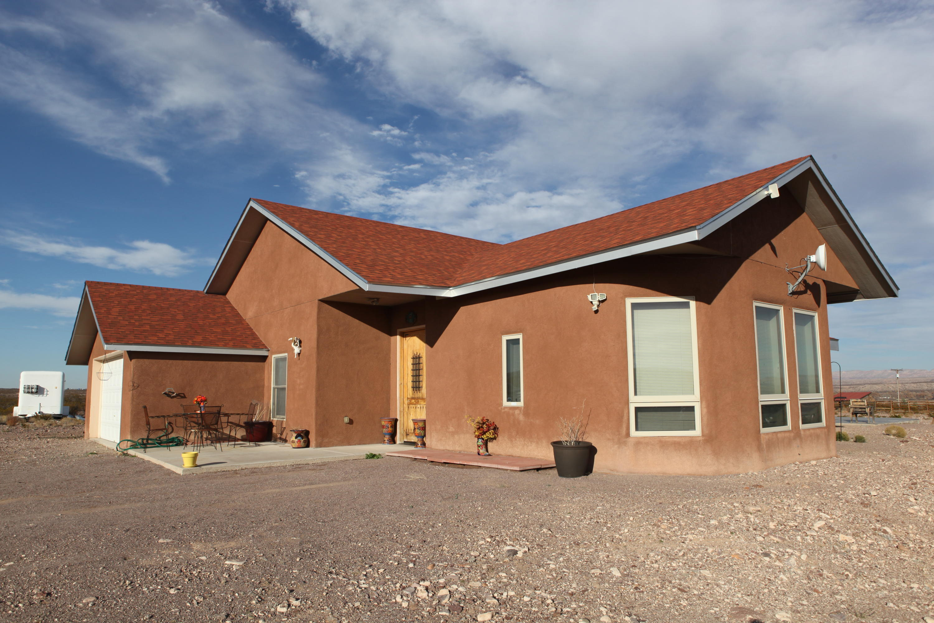Country living between Socorro & San Antonio. This Attractive Custom Built Rastra Block Home is on 14 plus acres. Complete with a fenced in dog kennel & a fenced in corral with a covered shed for your animals. Brick & Saltillo Tile Floors With Heating In The Floor. Custom Hickory Kitchen Cabinets. Eat-in kitchen, family dinning room. Spacious living room with a loft.  Vaulted ceilings with skylights. Two full size bathrooms with cultured marble shower, tile and corian  counter tops. A cozy jetted tub. Large walk-in closet. Heat on demand hot water heater. UV Water softener. Two car garage. Enjoy sitting on an open patio looking at the gorgeous mountainous views & unforgettable New Mexico sunsets. Private well & FREE internet. Come &make this your forever home! Mild winters & cool summers.