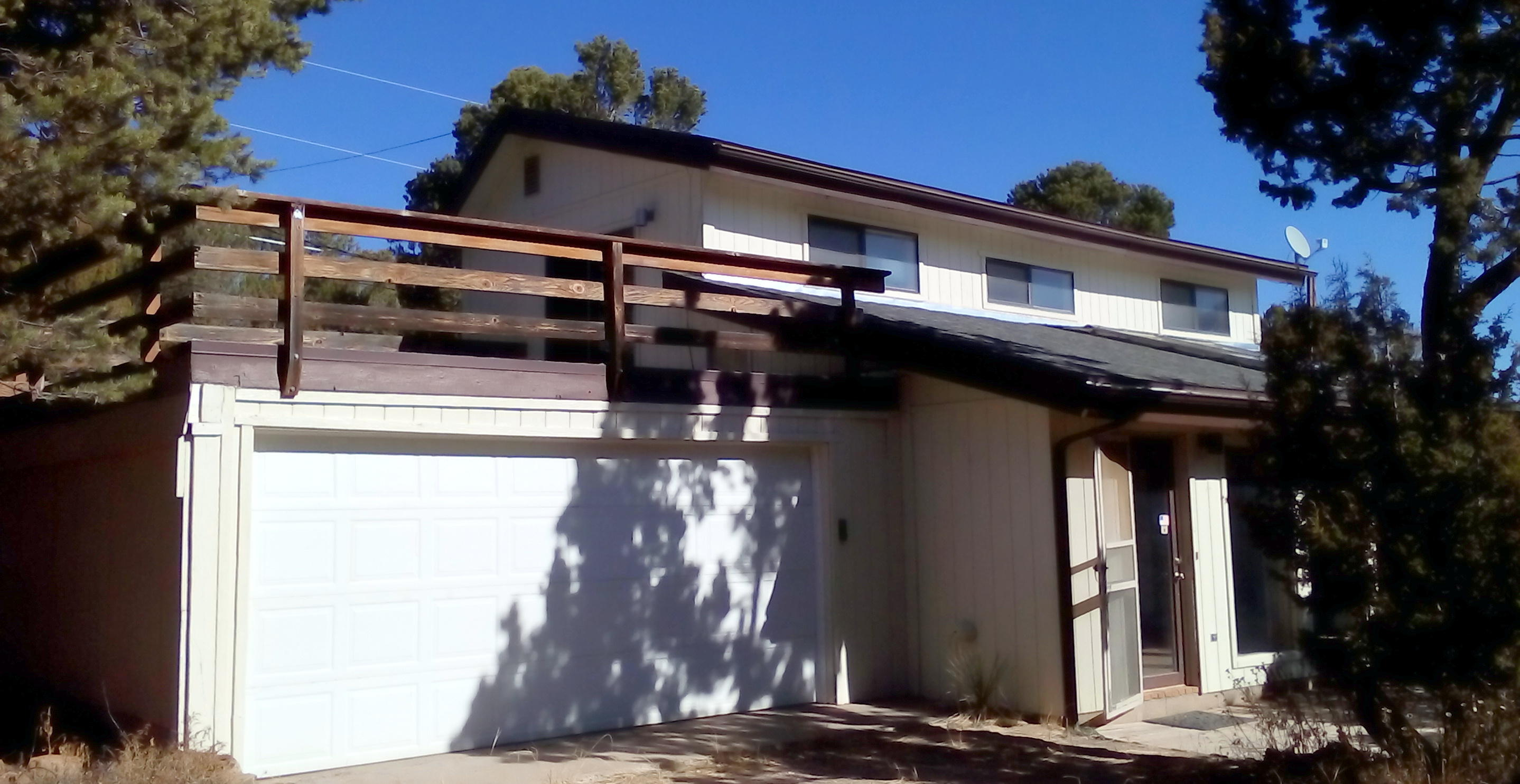 Located in highly desirable Sierra Vista Estates across the street from Milly's Meadow, this passive solar home is ready for new east mountain owners.  The main floor is a huge living area with open kitchen space and a beautiful brick floor.  The kitchen has been updated with a new range, vented microwave, and disposal.  Upstairs is a second bedroom, bathroom and a loft area for use as a bedroom or office with a walk out patio (20'X20') over the garage for relaxing and enjoying the surrounding views and wildlife.  The sun room offers a cozy breakfast nook amidst the trees.  A large (17'X11') hobby/laundry room offers a place for exercise equipment or gardening.  The house is connected to a reliable community well system with fire hydrants.  Come on out to the green side of the mountain and