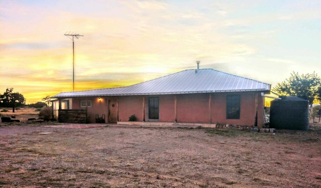 Amazing deal with 28+ acres on edge of town with a Beautiful Southwest home. Large living area, 2 bedrooms, 1 bath off paved road and walking distance into the town of Mountainair. Great views with plenty of room to have a horse, pets, and/or small livestock. Large 38x30 outdoor pavilion with two containers for storage and covered parking. The home is on town water and several water catchments installed for the landscape use. This is a great value and won't last long in this market. Make New Mexico your home now!