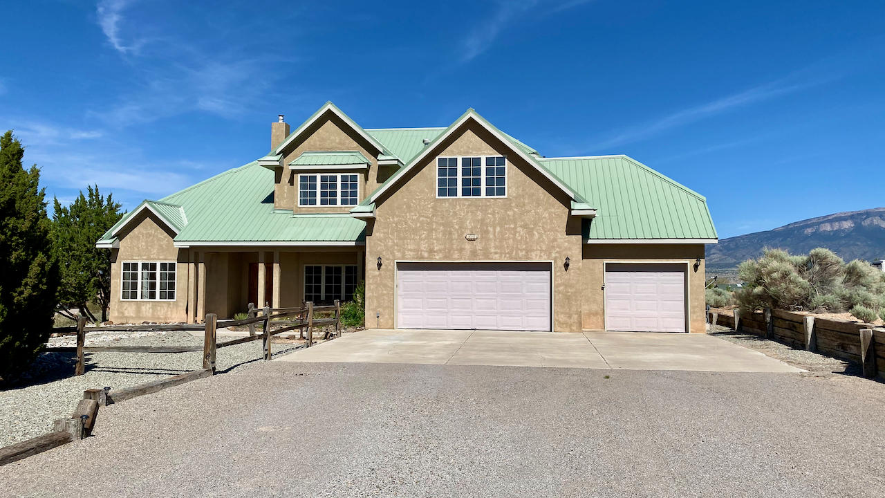 Charming Northern NM style home on a half acre lot in Vista Entrada. There's plenty to enjoy in this home - from the expansive mountain views, 2 master suites ( 1 up & 1 down) perfect for extended family living, multiple living areas for a den, office, movie room, play room, craft/hobby room, exercise space - whatever you need. Did I mention the views? The updated kitchen is a cook or baker's delight. Quartz countertops, stainless steel appliances, 2 ovens, a prep sink, 5 burner gas range, lots of counter space and a huge walk-in pantry plus those enchanting mountain views from the kitchen & dining room. There's new paint throughout and wood flooring in the downstairs master and den/office. Other features include wood windows, refrigerated AC,