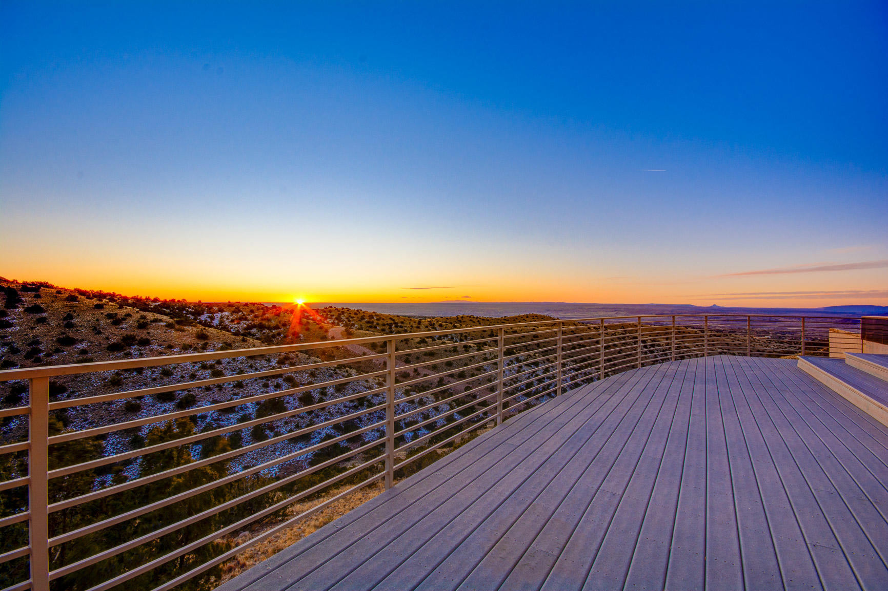 Exquisite custom contemporary home located on the top of the hill on 2.71 acres boasting breathtaking views from most everywhere... walls of windows take in the endless skies, rolling hills, distant mountain ranges. Multiple outdoor patio areas on the north & south where you catch a glimpse of the vast wildlife, fiery sunsets, snow-capped mountains & those coveted city lights as you swim in the glistening pool, it's dramatic! 2 spacious living areas, theater, stylish kitchen w/huge butlers pantry, island & bar, all designed for living & entertaining.  3 bedrooms en-suite, a gym w/sauna & steam room, awesome! Here's a treat, it's got an attached studio/workshop, classroom or home office for 2! A famous movie was filmed here in this elegant, classy & one of a kind home in beautiful Placitas!