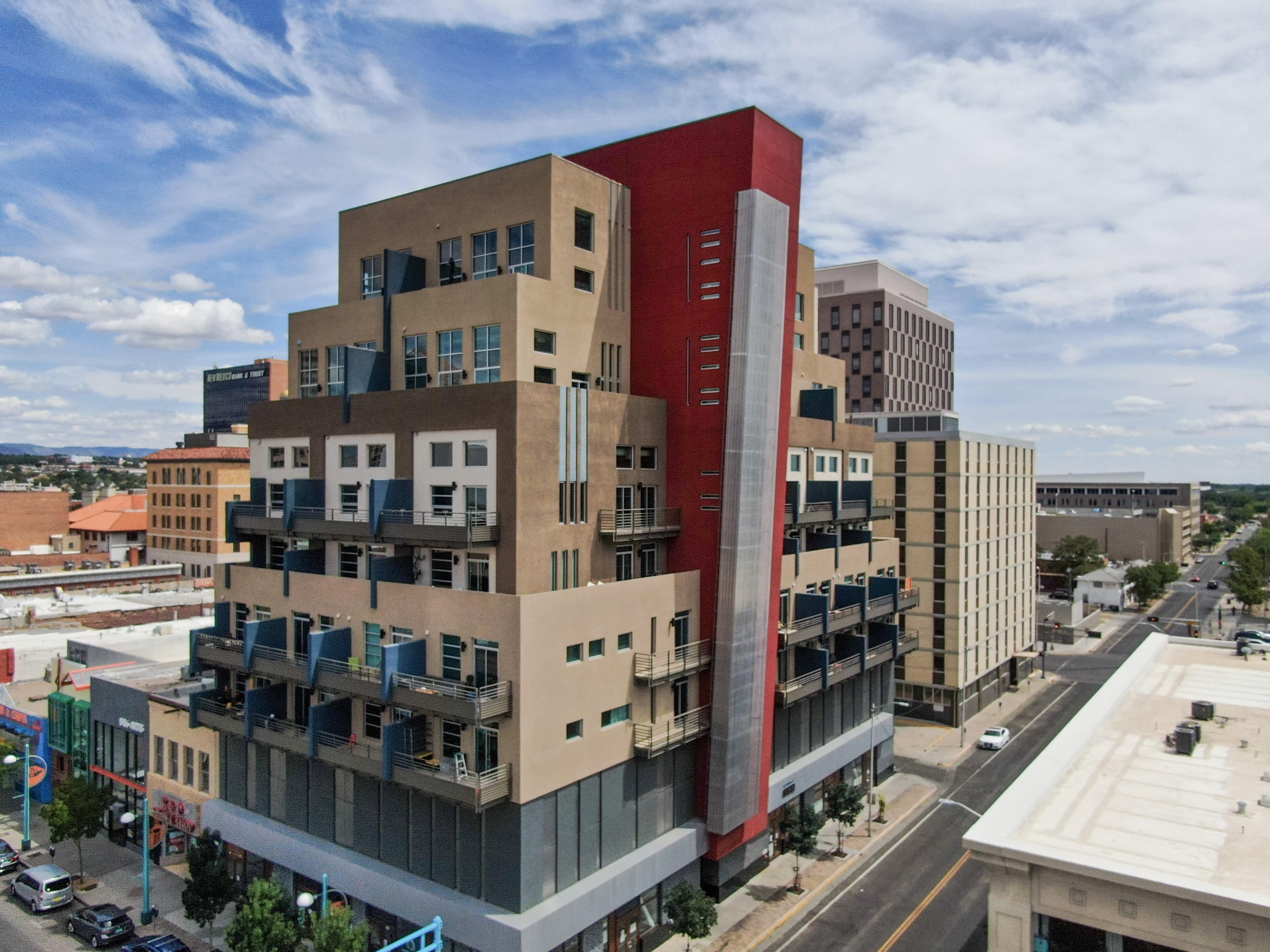 An amazing opportunity to live in a luxury condominium in the heart of Albuquerque. Experience this unique loft, with it's high ceilings, lots of natural light both downstairs and upstairs. Views towards the North East, for some interesting downtown skyline and Sandia mountains beyond.The upper floor is entirely dedicated to the master bedroom suite, with enough room for either an office or extra living area overlooking the downstairs living/kitchen area. Equipped with it's own washer/dryer. With it's own parking with secured access, this building is one of the newest downtown condo buildings, if not the newest (completed in 2015).Priced at $175/sqft for a quick sell, lofts in this building have appraised for up to $240+/sqft.