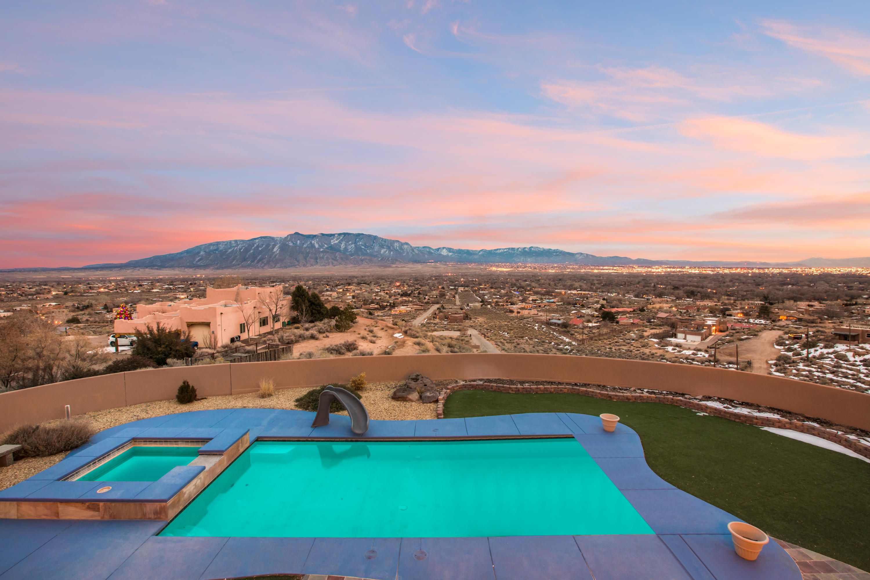 For the buyer who values jaw dropping views and privacy, this property is not to be missed. A long gated drive welcomes you to one of Corrales' finest properties with ever-changing views of the majestic Sandia Mountains, remarkable sunsets, and twinkling city lights. This spectacular custom home was designed to take advantage of the views from it's hilltop location. Beautiful craftsmanship awaits with hand scraped distressed hardwood floors, rich alder custom doors and furniture grade cabinetry, beautiful wood windows to frame the views, and beautifully designed tile layouts. Enjoy the ever-changing views from the backyard with a custom gunite swimming pool with a hot tub, a wood burning kiva fireplace & fire pit. Main level master is beautifully appointed with sauna & steam shower.