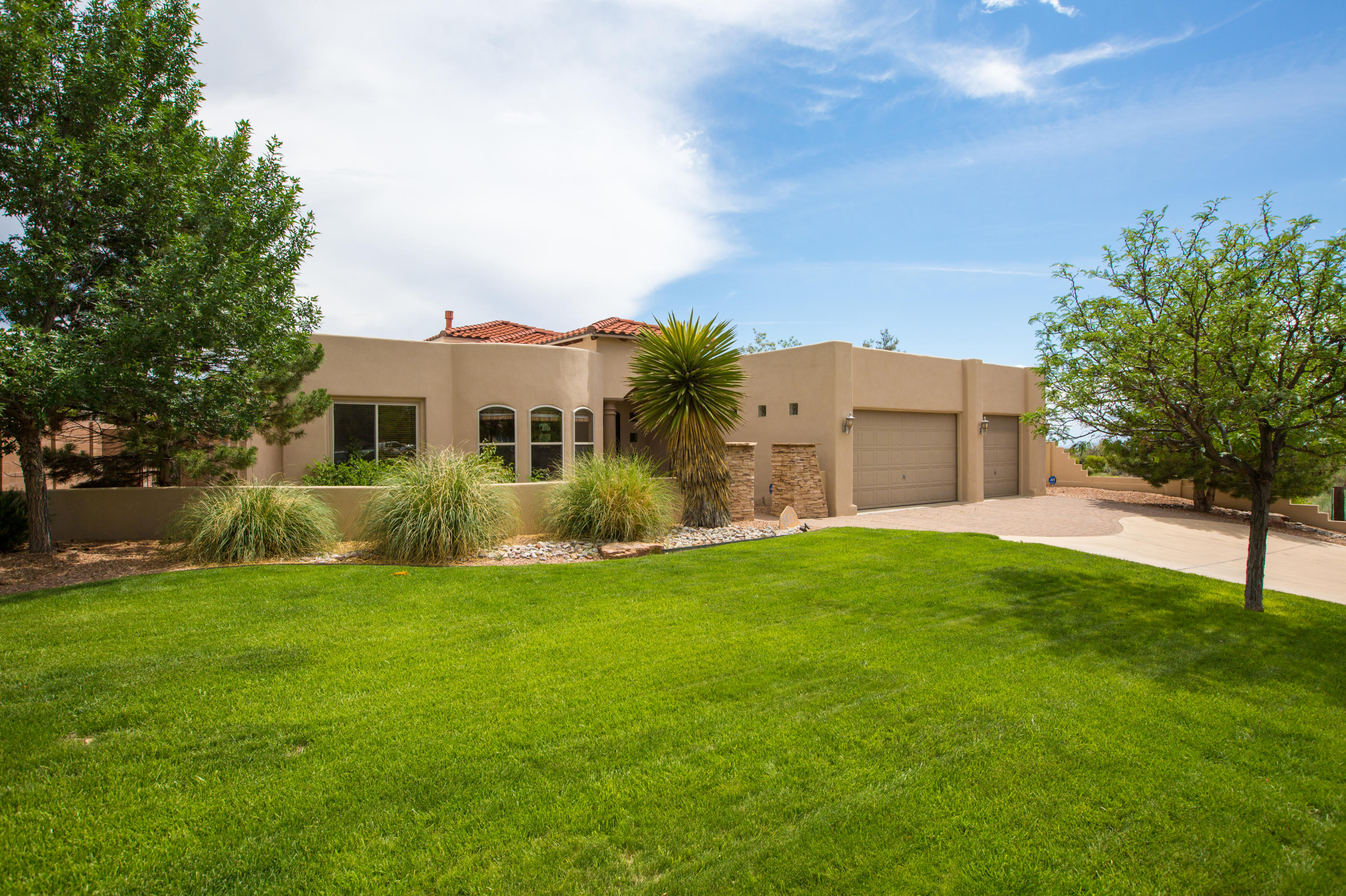 Stunning New Mexican, Single Level Custom Home in Highly Desired North ABQ neighborhood of Primrose Pointe. Naturally Bright & Inviting Well-Cared for home w/T&G ceilings, arched doorways & custom touches throughout. Surround Sound In&Out, Open Gourmet Kitchen w/Granite, Sunny Breakfast Nook, Sub-Zero & Wolfe Appliances, Kinetico H20 system. Exquisite Master Suite w/Large Walk-In Cali. Closet, Huge Bathroom w/Jetted Tub & FP. +2 other Master Suites w/Full baths. Office off main entrance has Beautiful Views of the nearby Sandia Mountains & can serve as a fourth bedroom. Roof-top deck w/360 Views of the Rio Grande Valley & surrounding mountains. Close to Trails, Park, Grocery, Retail. Ease of access to Paseo Del Norte & Tramway Blvd.