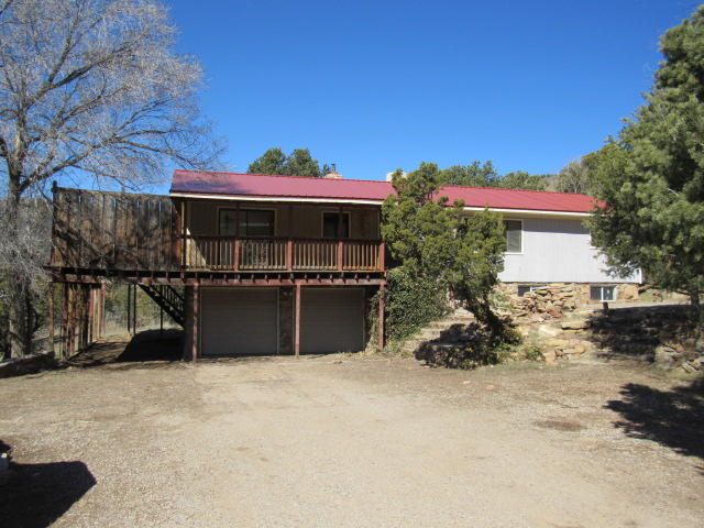 This spacious East Mountain property is located on over an acre of land! Pretty mountain setting with views from the deck. Make this property into your dream retreat!