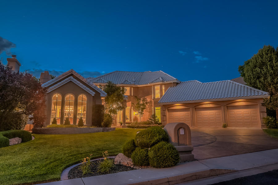 Exclusive Inverness at Tanoan Country Club East! Magnificent Custom on a Lush/Golfcourse View Lot; Panoramic Golfcourse, Mountain, City & Sunset Views! Perfectly presented; dramatic entry overlooks the custom Artisan wrought iron stairway, formal living room w/wood flooring opens to formal dining room & bar room, all w/access to entertainer's patio, upscale Master Chef's gourmet kit w/quality appliances & dining area opens to the family room w/fireplace, all w/access to a view deck, library/office leads to the gameroom & separate in-law qtrs w/kitchenette, Upper level; 2 Jack & Jill guest BDRMS each w/sep bath/vanity, private/spacious MBR Retreat up w/frpl, luxury bath, big walk-in closet & access to a panoramic view deck. Quality Appointments, Quality Design! Expect to be Impressed!