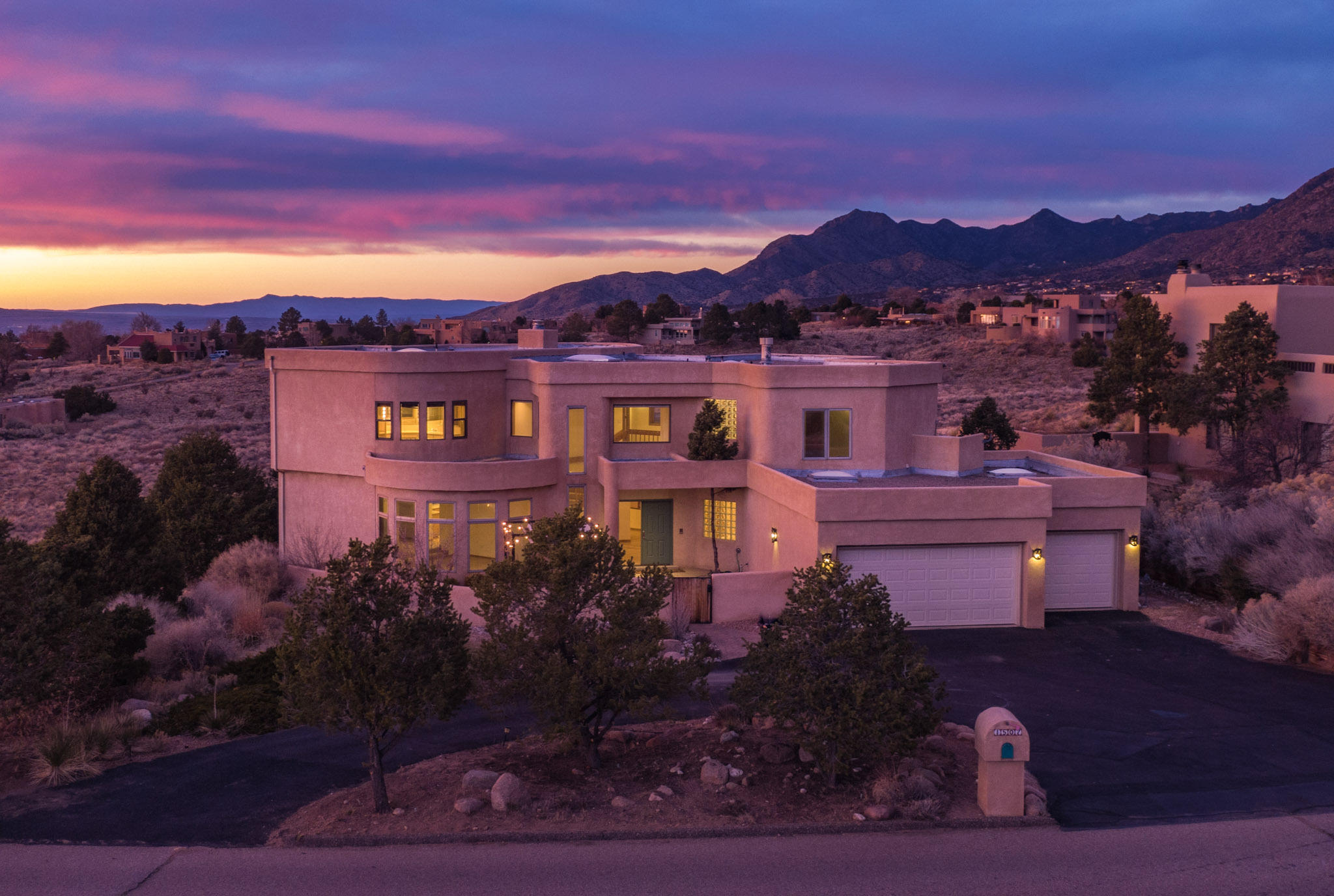 You will find incredible construction and attention to every design detail in this beautiful contemporary SW home. The idyllic 1.5 acre setting offers panoramic views of the Sandias, Arroyo, City all the way to Mt. Taylor. The interior features dramatic raised ceilings, multiple livng and dining areas and walls of windows north and south which draw in the mountains and tons of natural light. Professional landscaping front/back with multiple patios and an elevated deck to take in all of the views and nautral surroundings.  The master bedroom is a retreat with view deck, office area, view windows and a spa like bathroom. The chef's kitchen is a fantastic gathering/entertaining space with large pantry and breakfast bar. This home is truly one of the most unique properties in Sandia Heights.