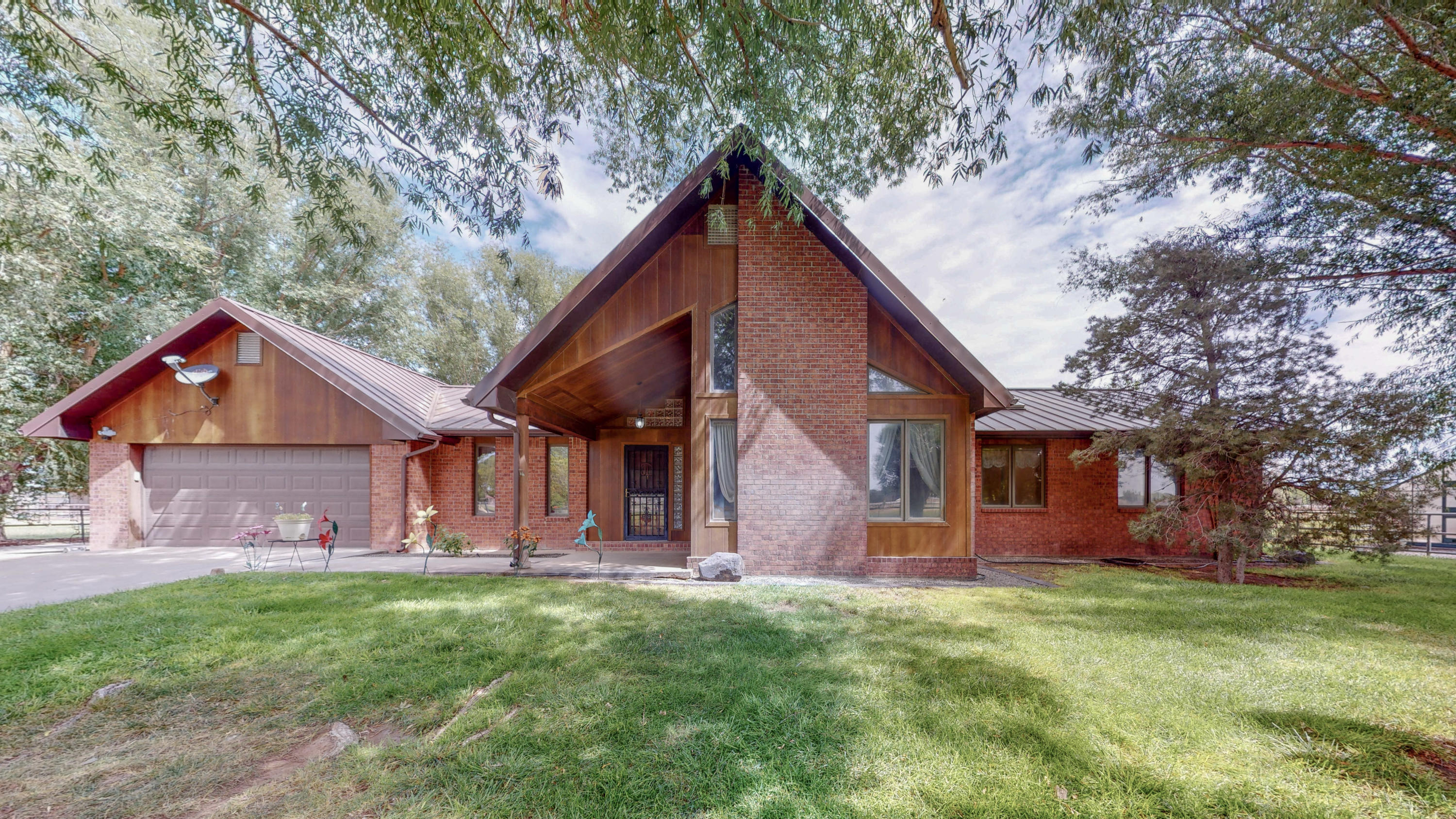 This amazing and completely pipe fenced property has 6.1 acres of country living located in the los Chavez area, with easy/quick access to I25. The house is just over 1900 square ft, with great amenities and updates! Step out the back door and enjoy the shaded patio, and the in ground pool with a beach entrance! Walk around the side of the house and you will find a lovely custom green house, just perfect for the home gardener! Load up your horses and bring them too! There is plenty of room in the five stall barn to house your horses, with the ability to open 2 stalls into a large foaling stall, there is also a larger stud stall and three runs outside the barn. This property also comes with an equipment shed, a large hay barn w/wood floor, a shop, and a shed row barn. A must see!!!