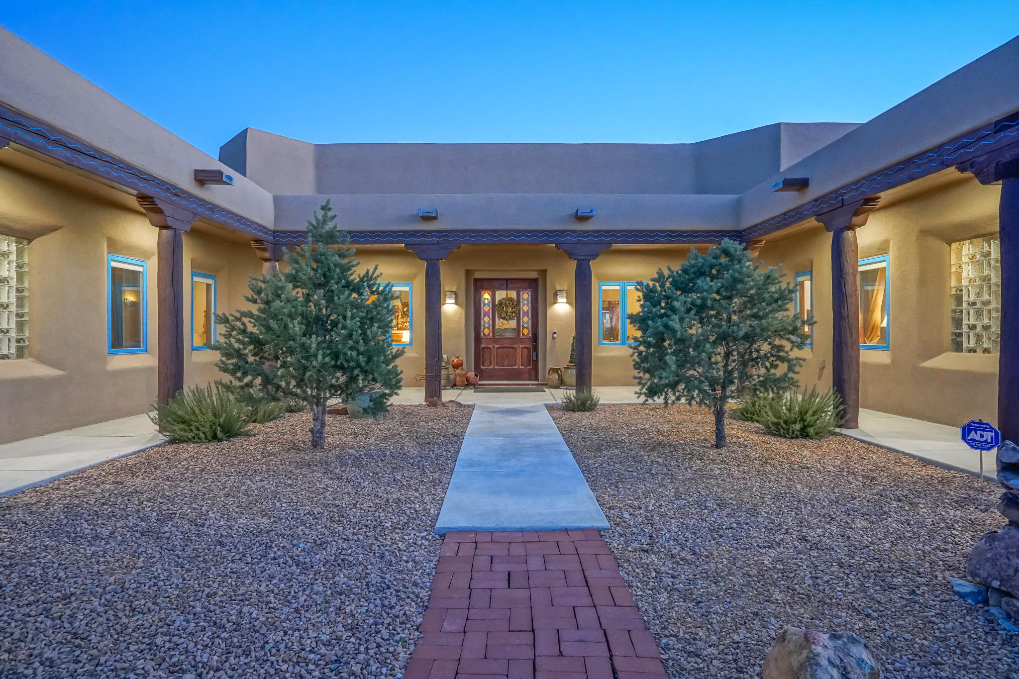 Palatial Santa Fe meets Craftsman Style Hacienda on .89 acre; luxurious mecca for large indoor & outdoor gatherings, warm brick radiant heated floors, 4 Kiva fireplaces, 5 bedrooms, 3 car garage, Pella wood windows, artisan woodwork, hand carved doors & carved posts, furniture quality handcrafted soft close dove-tailed cabinetry, custom wood trim w/ silver finials, adobe accents. Owners Wing, 2 way fireplace w/ attached den/office/exercise, beamed ceiling, double sinks, jetted tub, travertine shower, large walk-in closet. Chef's entertaining kitchen, 4 Wolf ovens, 4 burners, griddle & grill, Sub-Zero frig/freezer, walk-in butler's pantry, full outdoor kitchen and outdoor playground, cable/ethernet in every room, IT room command central. Close to everything! North Abq Acres at it's finest!