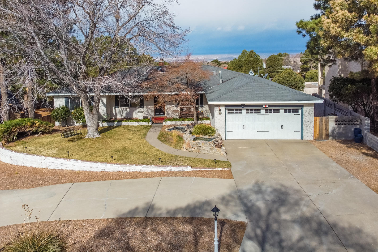 You really CAN have it all! Beautiful mountain views, swimming pool, tennis court (resurfaced 2018) , refrigerated air (2017), water feature, & a retro 50's dining area all on a cul de sac street! Exterior bricks are are done in an Old World style brick finish giving it the appearance of European whitewash! Kitchen appliances less than 3 yrs old. Hot water heater replaced Feb 2020. Electrical panel upgraded fall of 2019. AquaSauna home filtration & water softener less than 3 yrs old. Updates made to dining room, bonus room, living room, master bedroom, & deck. Newer lighting fixtures, fresh landscaping, security system approx 2 yrs old. Garage doors approx 2 yrs old. Home inspection completed! Don't let this one get away! See it today!