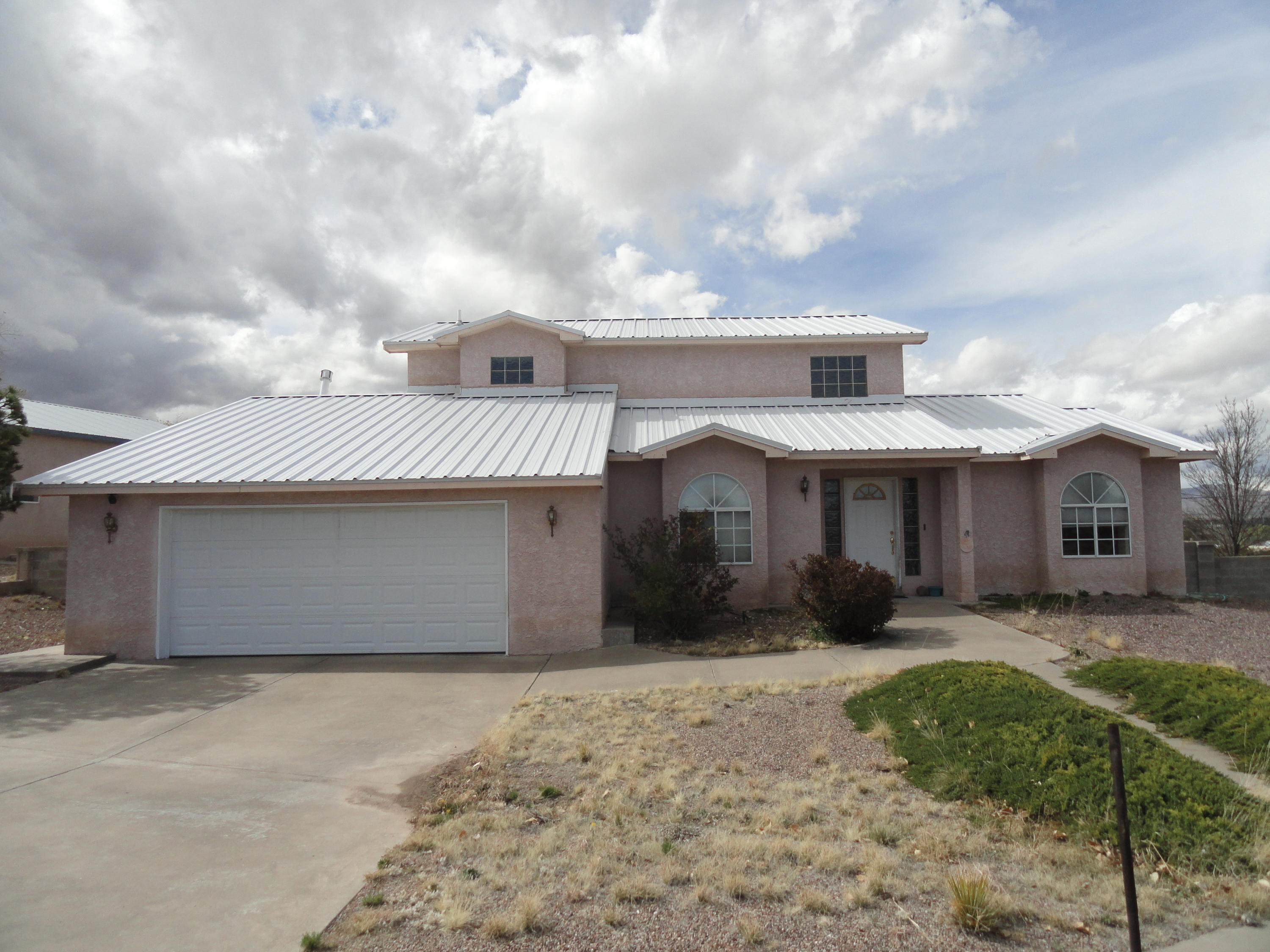 Beautiful Mission style home with large finished shop. Home features 2 spacious  bedrooms on ground level with lovely window seats. Grand master suite on upper level. Master features sitting area, newer slider to patio, Tongue and groove ceilings, Walk in closet, jetted garden tub, and separate shower. Kitchen has loads of cabinets, counters, and newer stainless fridge. Living area with cozy gas log fireplace. There is a 1/2 bath conveniently located by large laundry room. Shop is completely finished with 1/2 bath, heating, cooling, and will accommodate a RV.