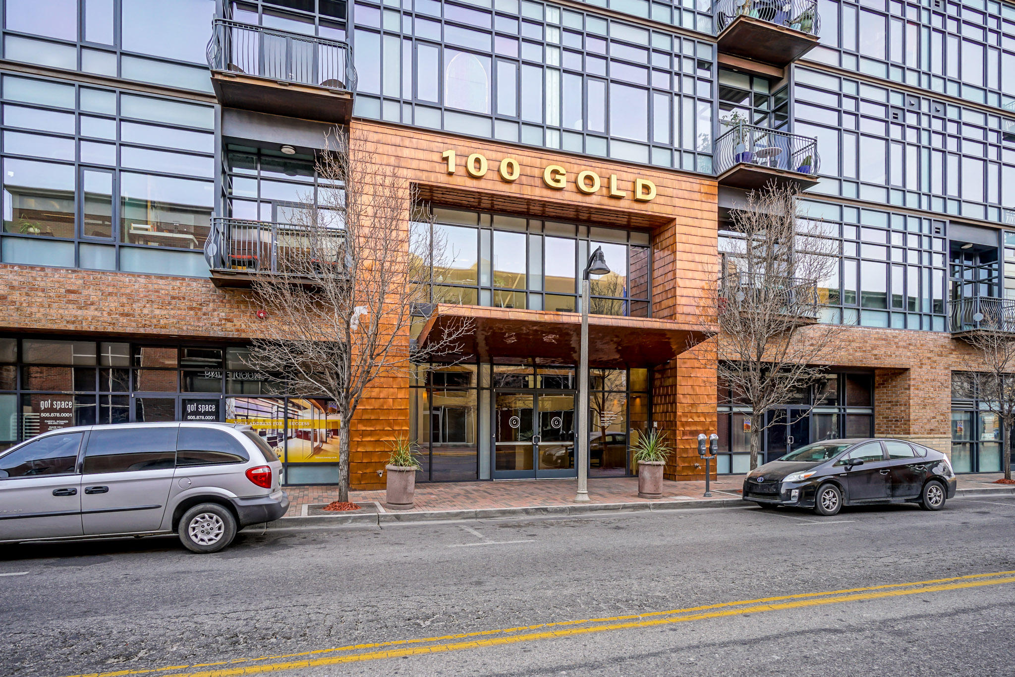 A sought after top floor corner unit at The Lofts At 100 Gold is now available. This stunning corner penthouse unit is warm and inviting. Amazing views of Albuquerque from the Sandia Mountains to the East and the.volcanoes to the West. Stained and polished concrete floors throughout the unit. The wood-burning fireplace is surrounded by custom built-in seating and shelves. Built in A/V shelves and cabinets in the living room and a built in desk and shelves in the master bedroom. Natural light pours through the over sized windows and French doors lead you directly onto the balcony.  High end stainless steel appliances including a Sub-Zero refrigerator. Travertine marble countertops . A full list of features and finishes in the documents attached. VIDEO TOUR A MUST SEE!