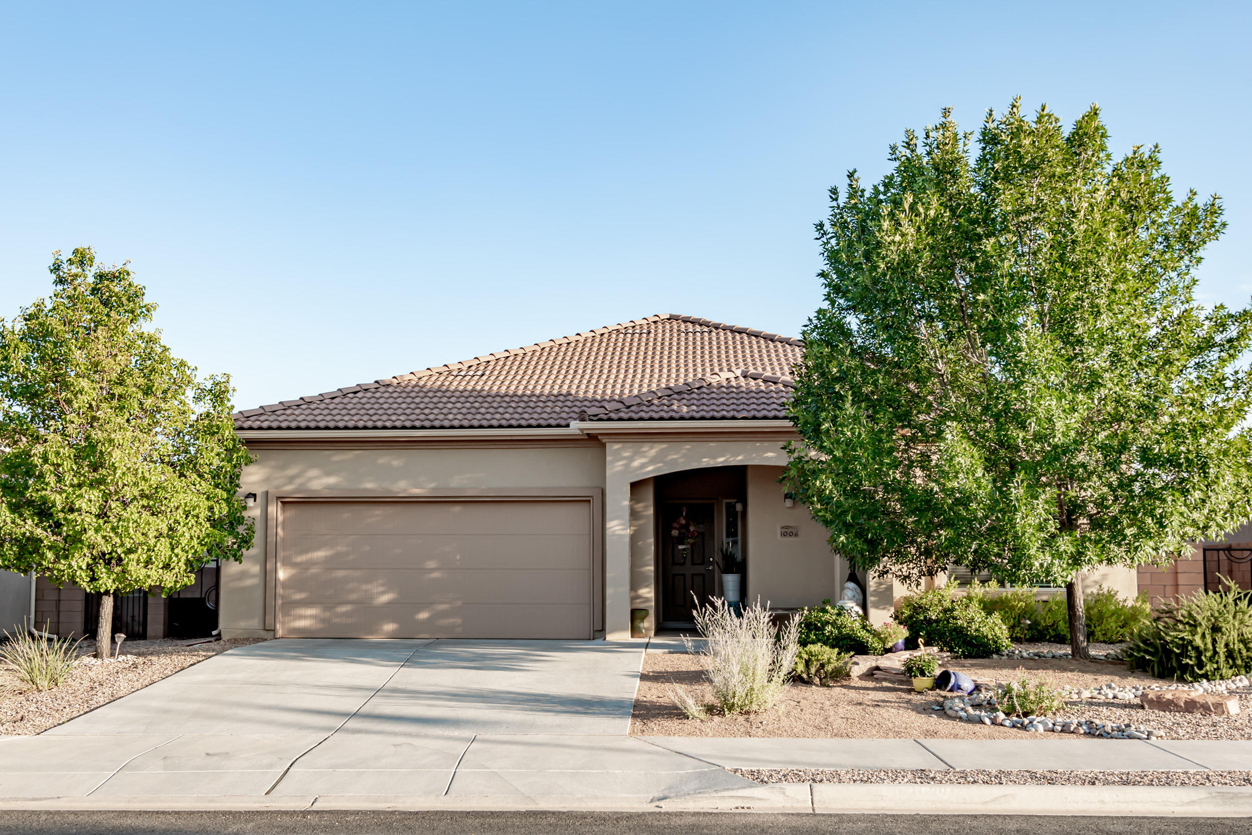 Nicely appointed 3BR plus an office/hobby room in NM premier gated 55+ active adult community by Del Webb located along the Rio Grande Bosque Preserve. Entire home is easy to maintain w tile flooring in all rooms except master BR. Open & bright floor plan w large kitchen incl. an upgraded island w a granite countertop & added seating. Lots of personality & charm has been added to this home incl. decorative shelving & accent lighting features. Granite counters & upgraded cabinetry in the laundry room. Fans in every room along with AC Refrigerated cooling keeps you cool in summer. Landscaped backyard w accent walls & added seating. Enjoy the indoor/outdoor pools, fitness club & outdoor game areas & walking paths for only $150/month. Min to shopping, eating, medical facilities, golf course