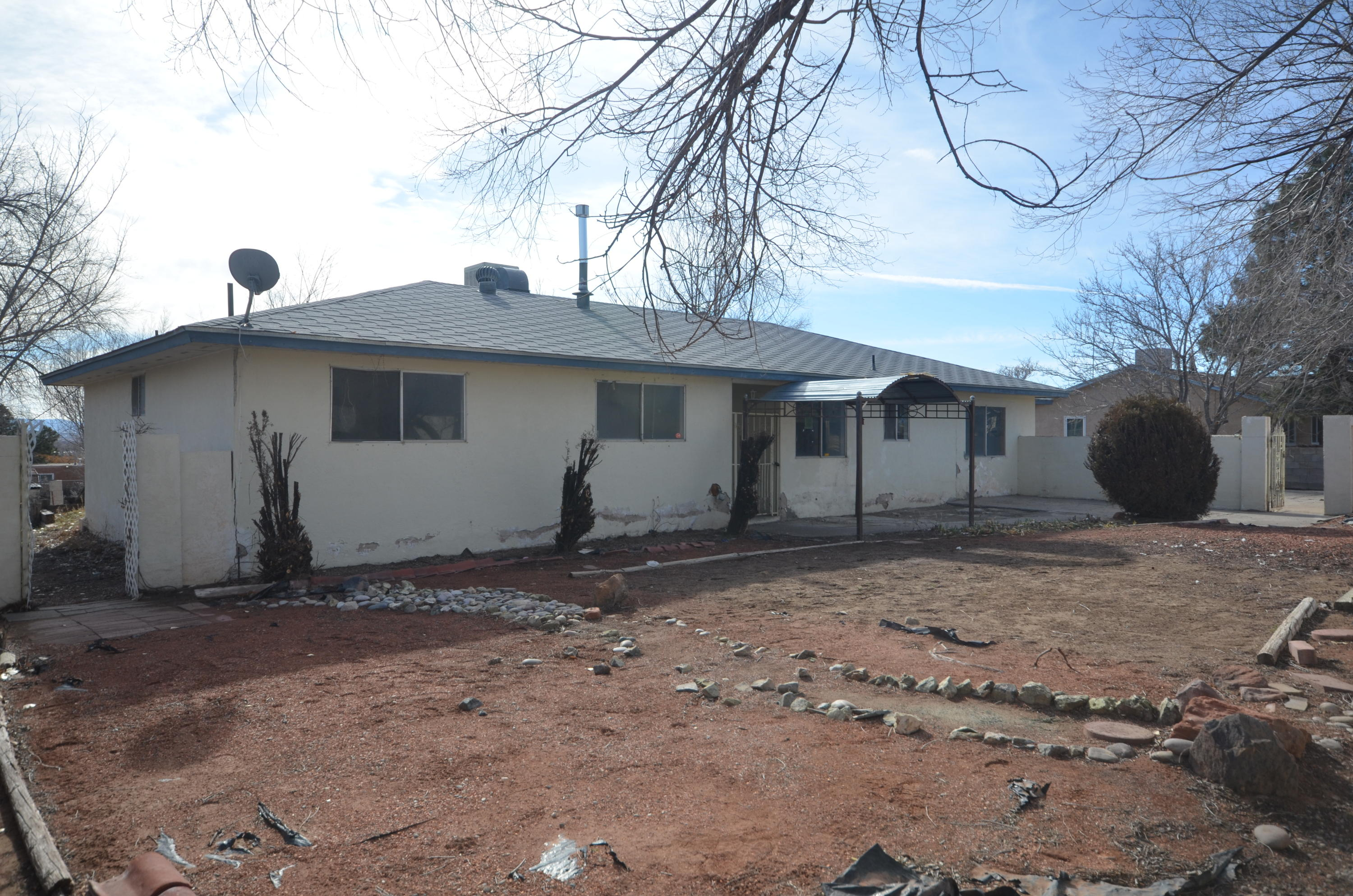 Bring your design ideas to this Corrales home and make it your own! 4 bedroom plus office excellent for growing family. Large living with cozy fireplace. Open kitchen / dining with breakfast bar. Don't miss out. Home is ready for facelift and new owners.