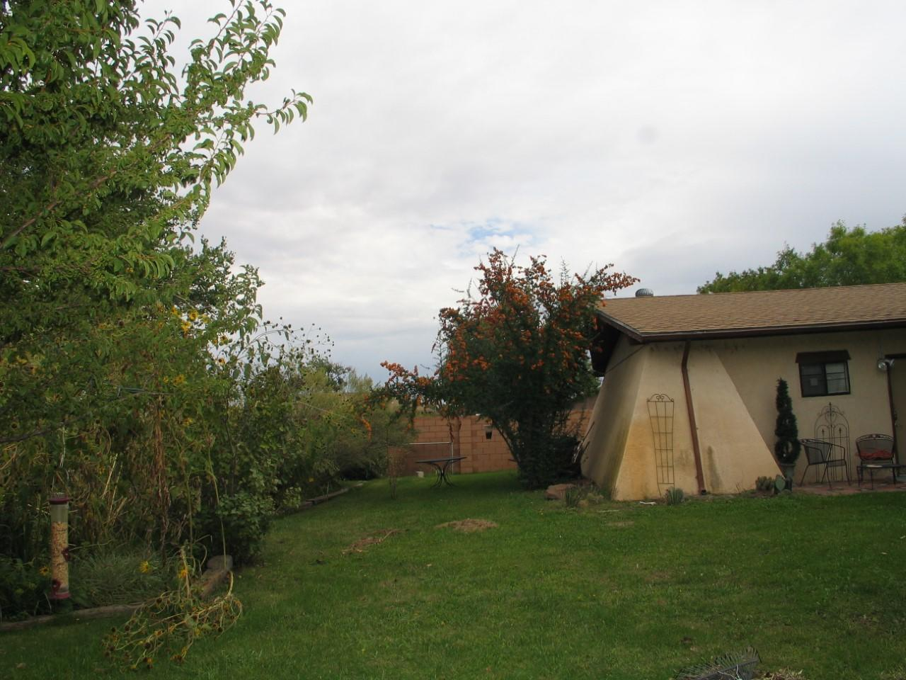 A 3 bedroom, 1 3/4 bathroom with great appliances such as a side by side refrigerator, dish washer, 2  large electric cooking stoves, nice kitchen cabinetss and plenty of them .A kiva gas-log fireplace,,large fenced area, a large detached garage.Refrigerated air and central forced air heating. Backyard fireplace and covered patio.