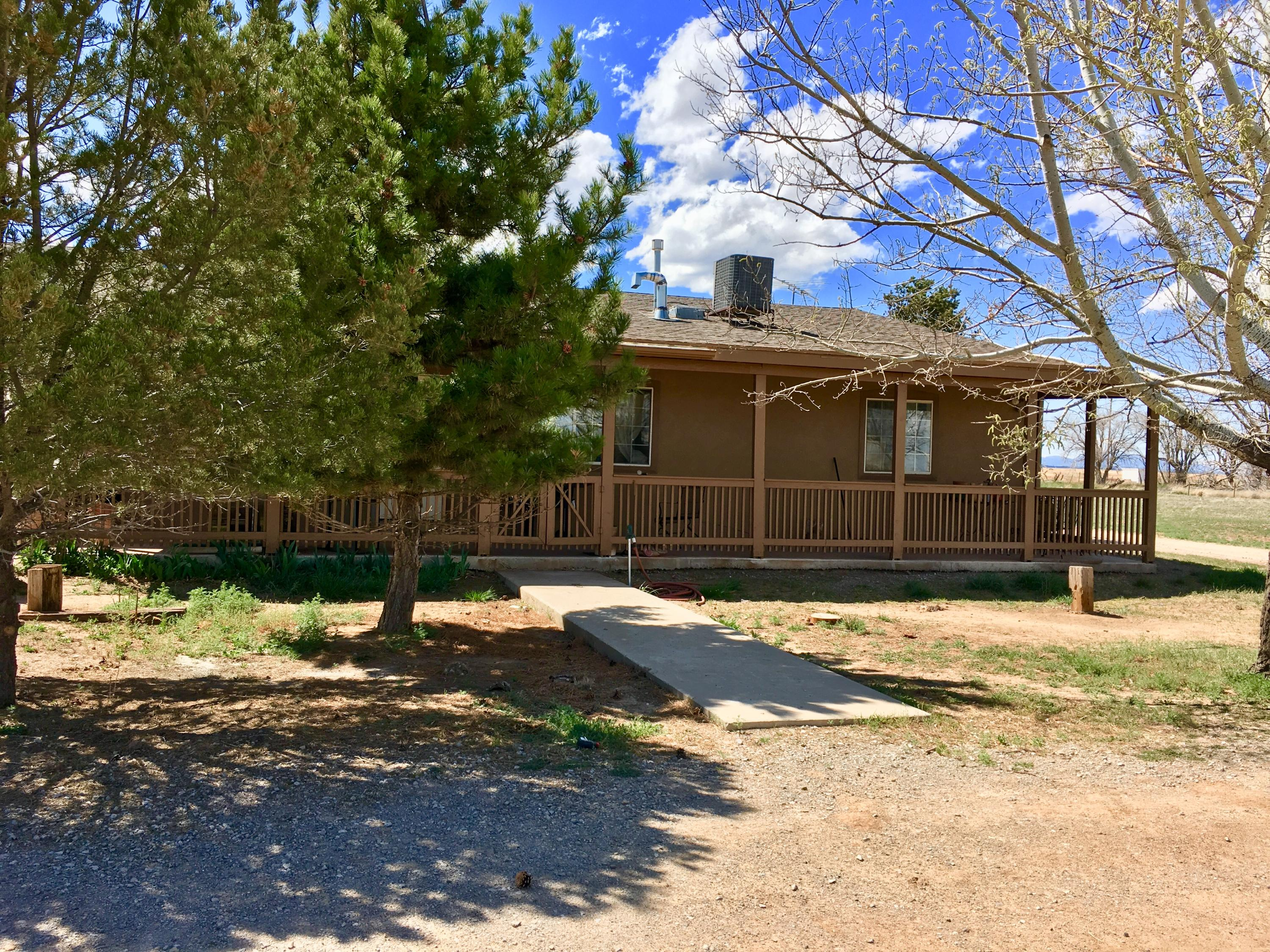 Beautiful & Unique home in the country! Ranch style home.   4 bedroom with an office. 2 bathrooms with a large 2 car garage.Beautiful covered patio.  On 5 acres.   This is a must see, it will not last!