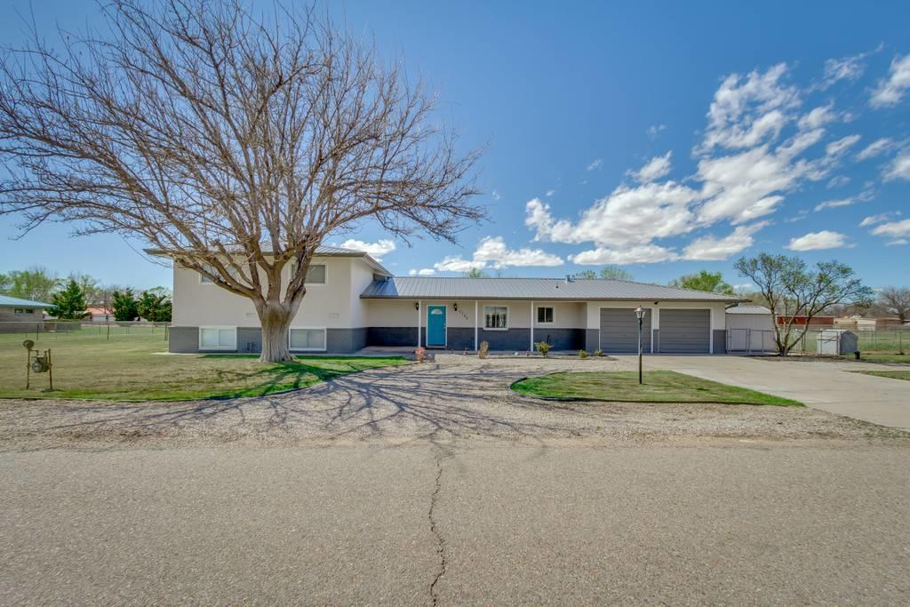 Come and see this amazing tri level five bedroom home in the heart of Bosque Farms! Surrounded by a beautifully mainained lawn with in ground irrigation system. This split level floorplan with two living areas was beautifully remodeled in 2018/2019 from top to bottom. Newer metal roof installed in 2018. Refridgerated air for those hot summer days and wood buring fireplace for those cold winter nights. Hurry this beautiful home will not last long! 360 degree home tour available as well as private showings.