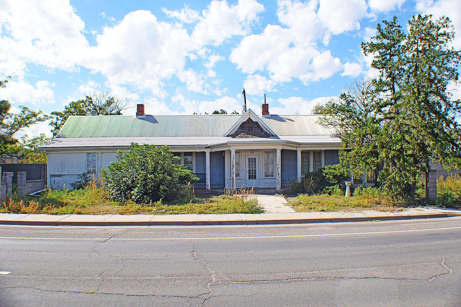 Victorian Exterior Design; Commercial Zoning; Huge Lot; & Main Street Exposure... are just a few great incentives for the person looking for the ideal investment.  Perfect for a ''Bed'n'Breakfast'' or a legal office or other great commercial business.  Property is completely fenced in, but has plenty of yard space available for a small RV Park.  The large country kitchen open to a huge dining area are ideal for the person that likes to entertain.  The traditional floor space boasts a huge foyer, formal living room, formal dining room, with some rooms having vintage metal, decorative ceilings and vintage light fixtures.  This is truly a ''Diamond in the Rough'' and will make a beautiful restoration for the right person.