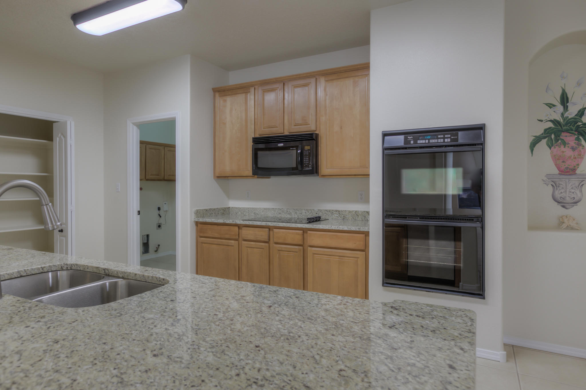 Nice Price Adjustment in this Super Popular Subdivision at  Close-in Rio Rancho!  This is a well built Centex home featuring great initial quality construction with quality updates. The Floor Plan is Open & has Two BRs down, both with Fans & a full bath down. The upstairs is exclusively a large Master Suite. Along with the 8+ ft x 8+ ft closet there is  a soaking tub, 2 sinks & separate shower. The high end kitchen amenities include Granite Tops, Bar, Double Wall Oven & Cooktop.  The Pantry is Double wide & has 42'' Hi Upper Cabinets with Crown Moulding.  The large format Tile Floors are everywhere except the BRs & 9 FT Tall Ceilings throughout both floors. Bonuses are Direct vent FP, Decorator color walls w/ white doors & trims, 2'' blinds, & Extra Garage Storage.  See it Now!!