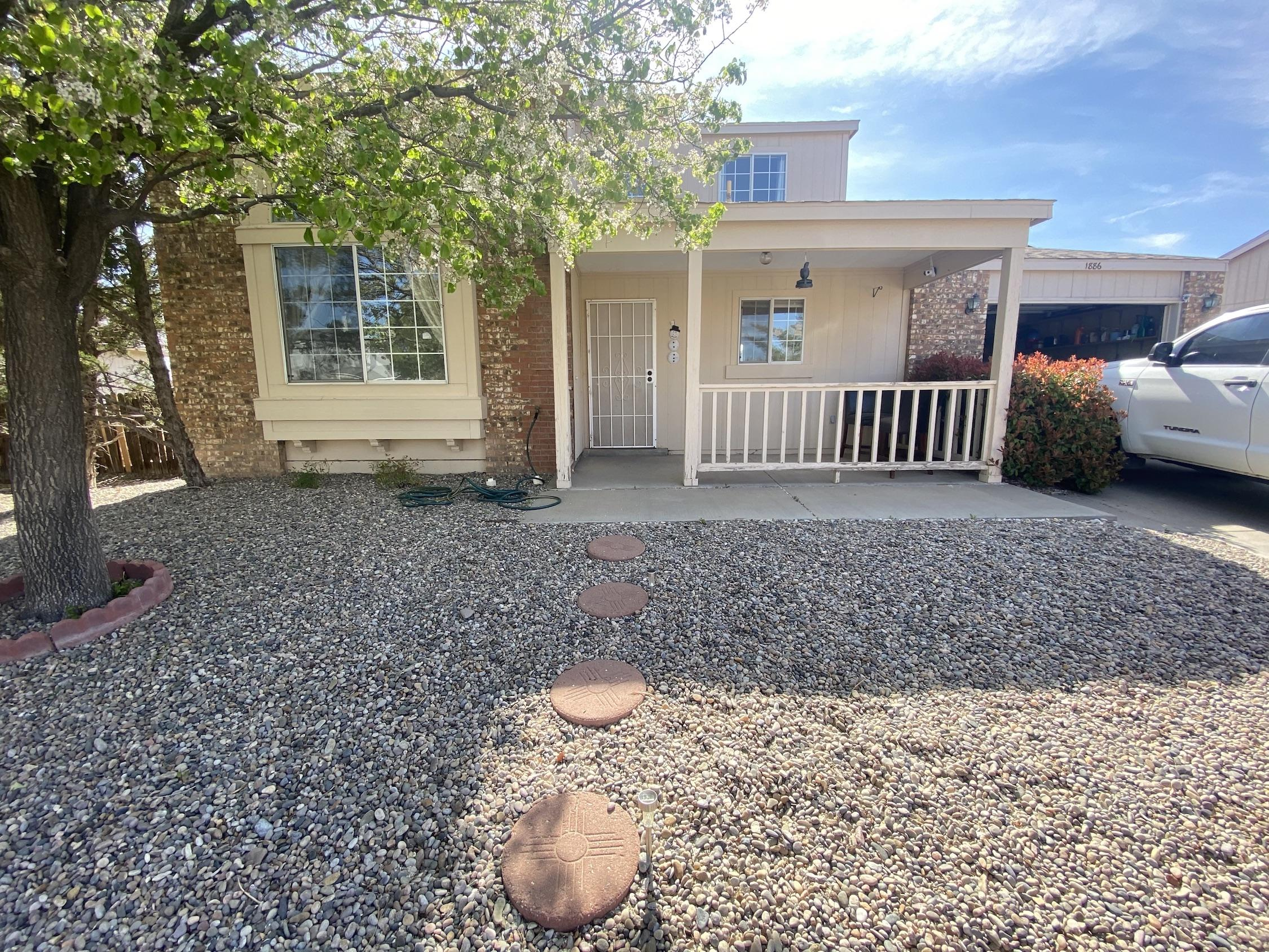 Great home that has really been taken care of. It has beautiful vaulted ceilings and lots of natural light. Floor plan is super convenient with 1 bedroom downstairs. Master bedroom and third bedroom are upstairs. This also includes a large backyard with possible backyard access. Solar panels also a huge plus. Come see it today before it is gone!