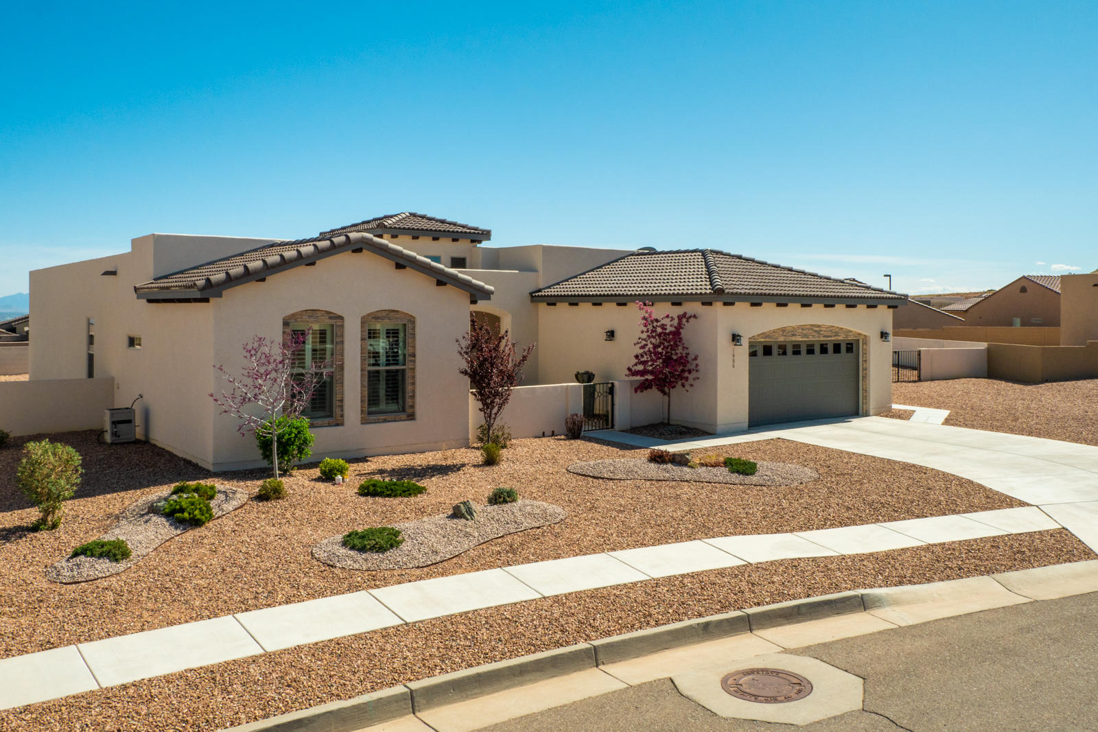 Stunning semi-custom home with sweeping mountain views!  Located in The Peaks @ Mariposa ! 6,500-acre community with 2,300 acres of open space, nature/trails, community center, indoor/outdoor pools, fitness center & parks.  This 2,600+SF home features 3 BRs, 2.5 BA & 3 car tandem garage.  The open concept plan has lots of natural light, coffered ceilings & designer finishes.  The gourmet kitchen boasts quartz countertops, Stainless appliances, and large Kitchen Island with attached dining area! Private Owner's Suite provides a luxurious Bath with walk-in shower and his/her walk-in closets.  Outdoor living at it's best with covered & open patio area, gas fireplace and extra large lot perfect to add your pool or office/casita.  Make this dream home yours today.  Virtual tour available.