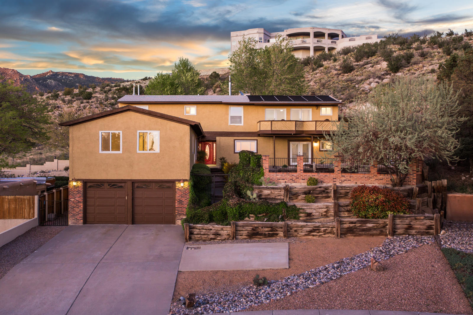 Sitting at the base of the foothills on 1/3 of an acre, this spacious 5 bedroom home offers breathtaking views of the city and mountains. The front of the home has a security gate that leads up a beautiful courtyard pool area. Inside, the home features a large open kitchen with granite counter tops, multiple living areas, and a private two bedroom suite above the garage. Solar panels are owned and are used to heat the pool. Roof was replaced in 2013 and a home inspection was performed in 2018 with more home information.